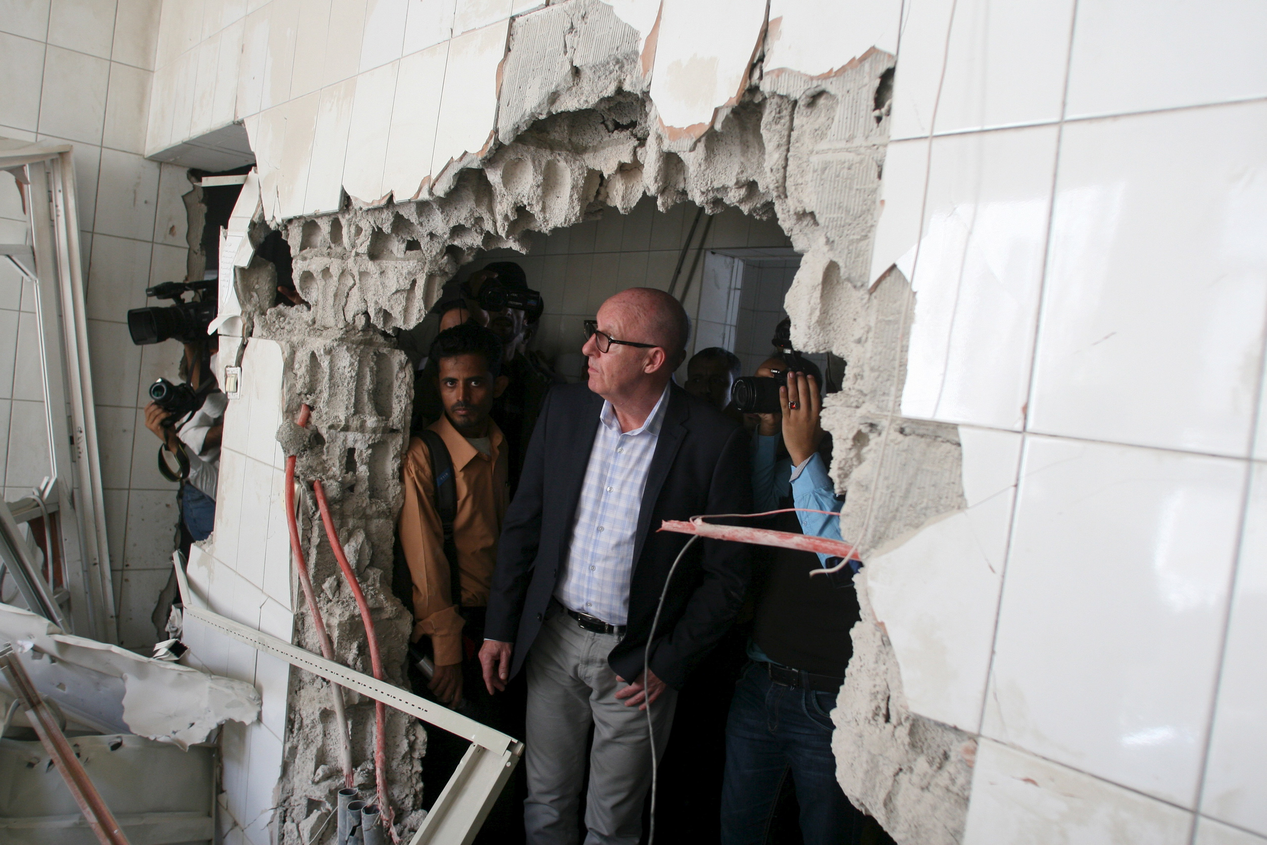 Resident Coordinator of the United Nations in Yemen, Jamie McGoldrick, inspects damage at a hospital in Yemen's southwestern city of Taiz on Jan. 21, 2016.