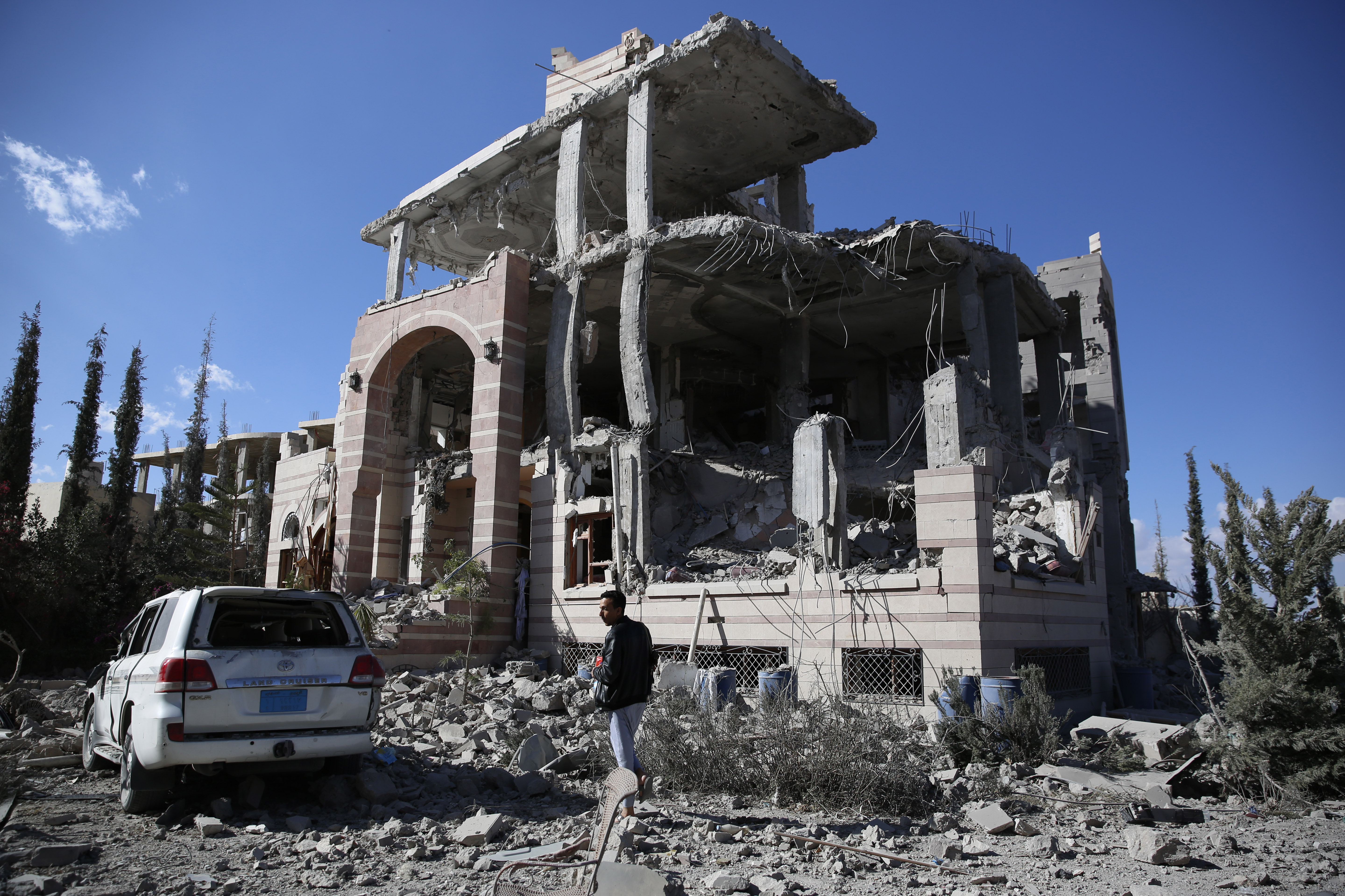 A man inspects his house destroyed by Saudi-led airstrikes in Sanaa, Yemen on Jan. 8, 2016.