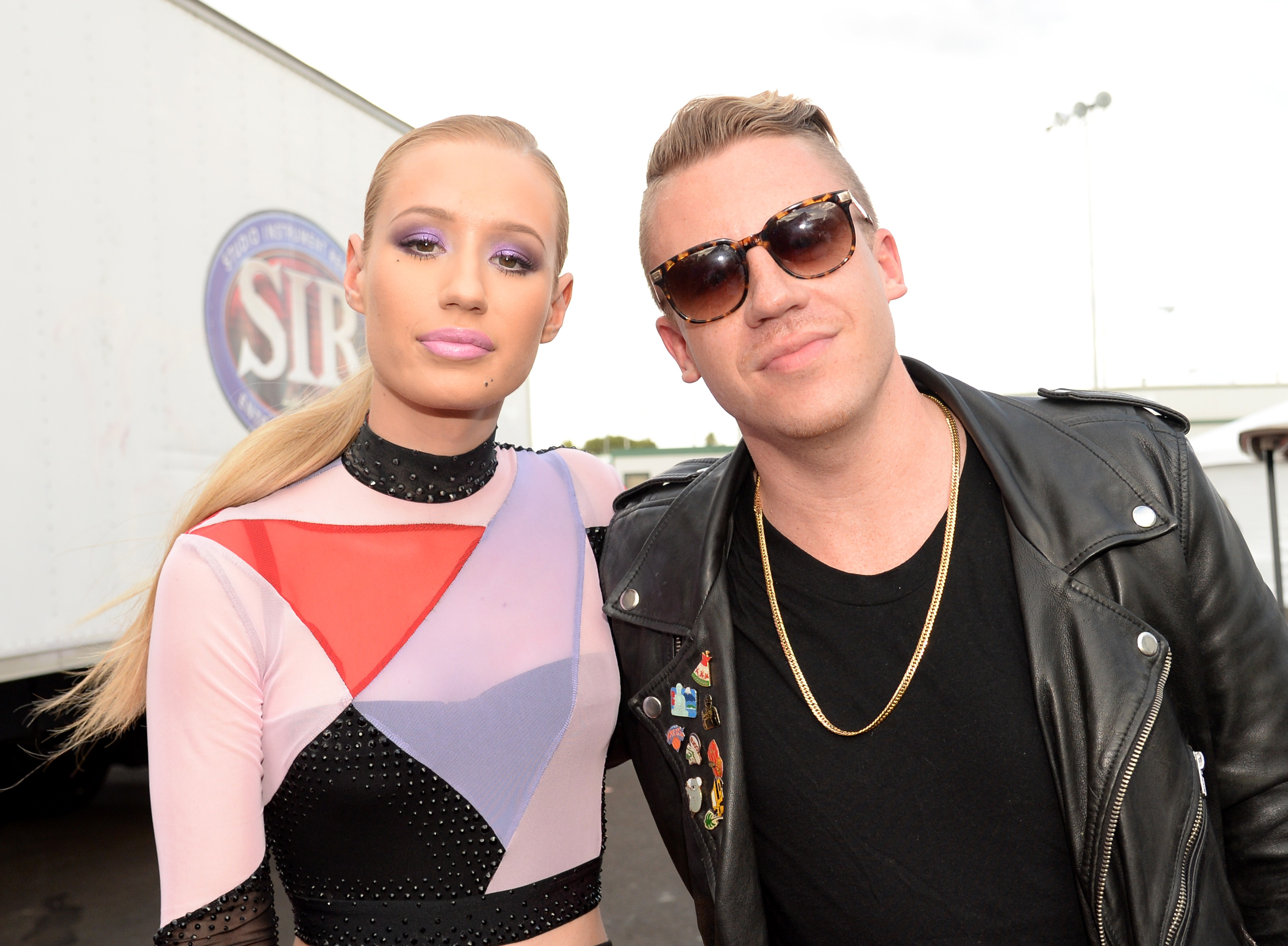 Rappers Iggy Azalea (L) and Macklemore attend the 2014 iHeartRadio Music Festival Village on September 20, 2014 in Las Vegas, Nevada.