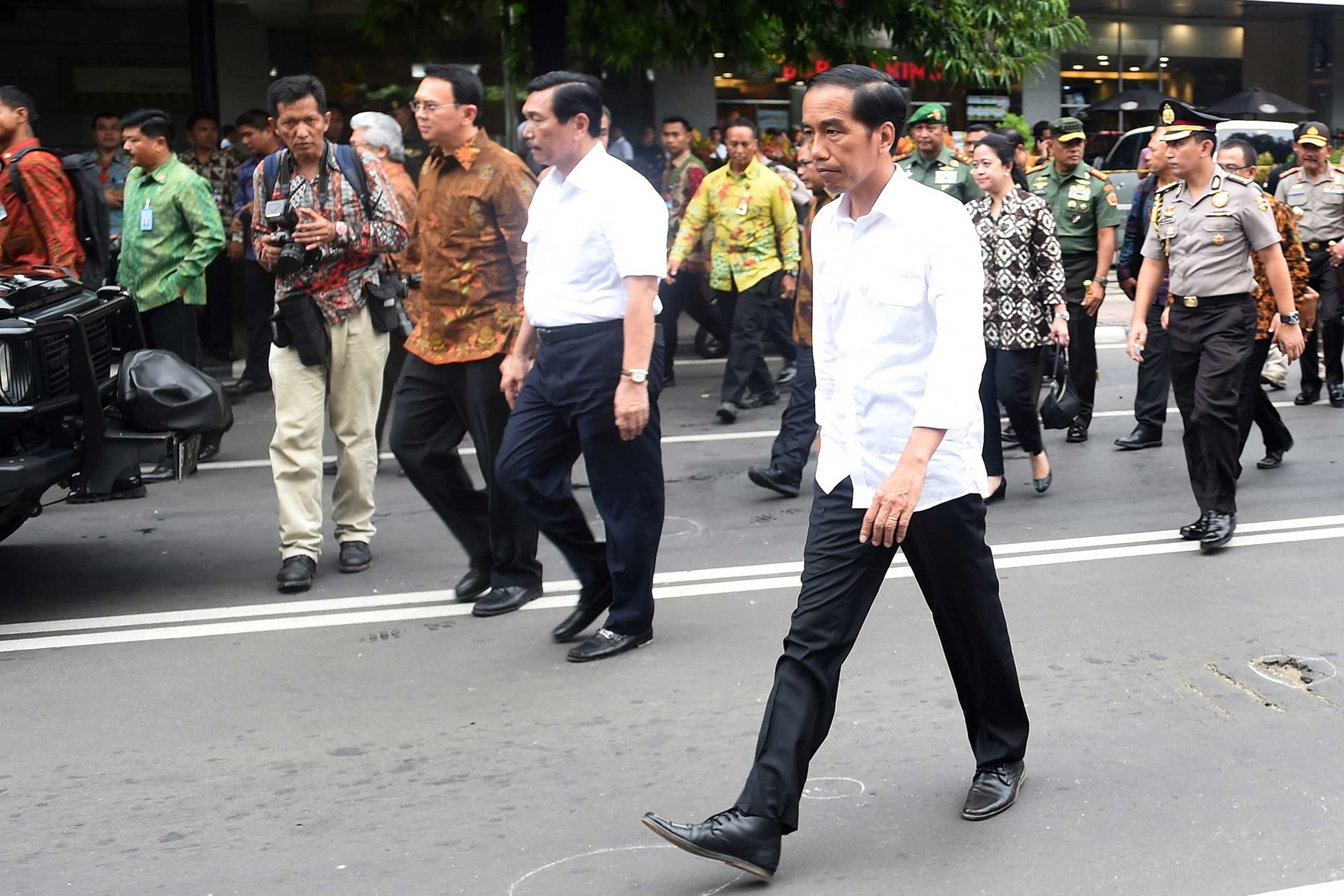 A handout picture provided by the Indonesian Presidential Palace shows President Joko Widodo visiting the blast site near a shopping mall in Jakarta, Indonesia, Jan. 14, 2016. At least seven people, including five suspected assailants, died in bomb blasts and gunfire in the attack.