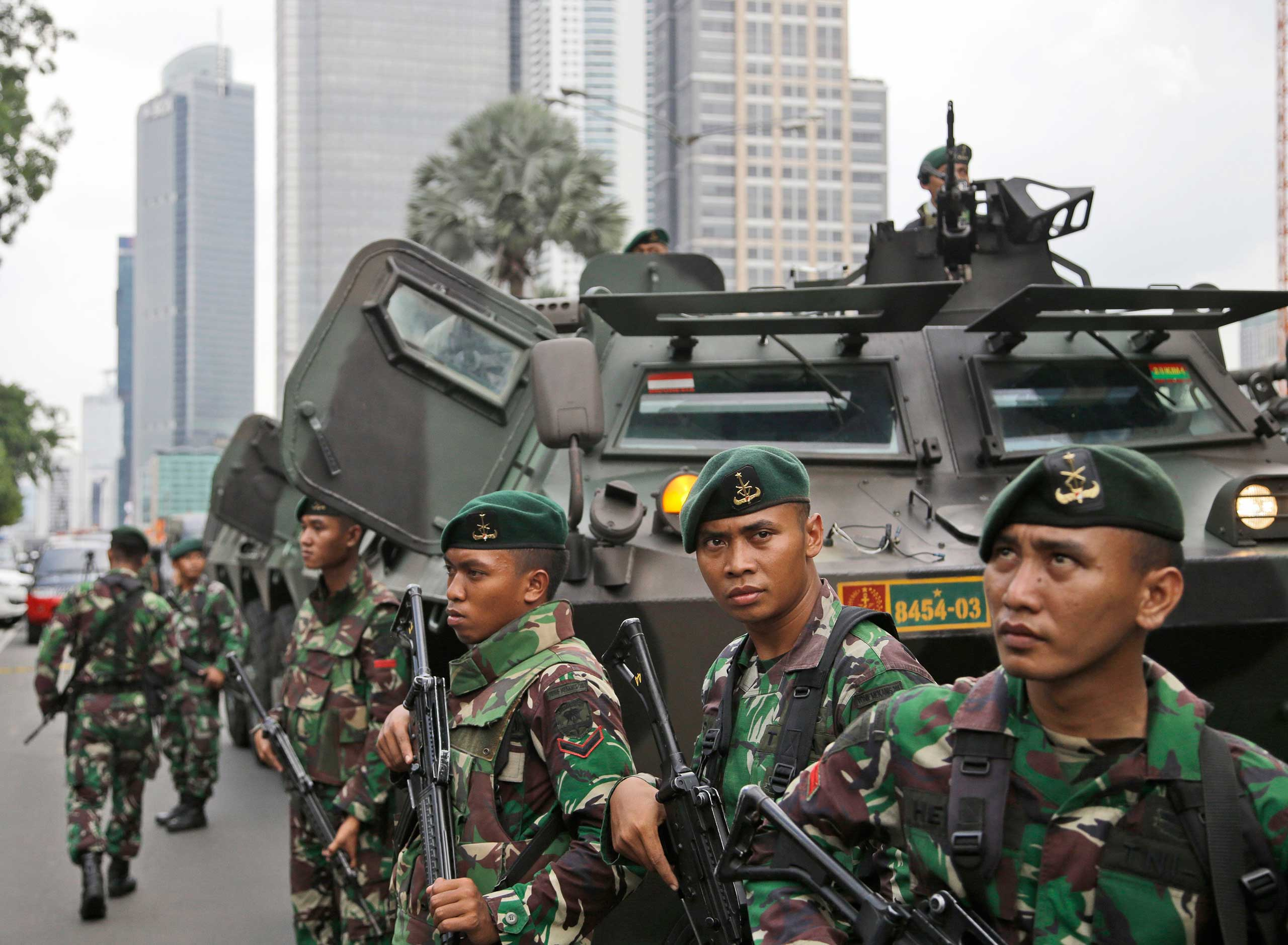 Soldiers stand guard near the site where an explosion went off in Jakarta, Indonesia, Jan. 14, 2016.