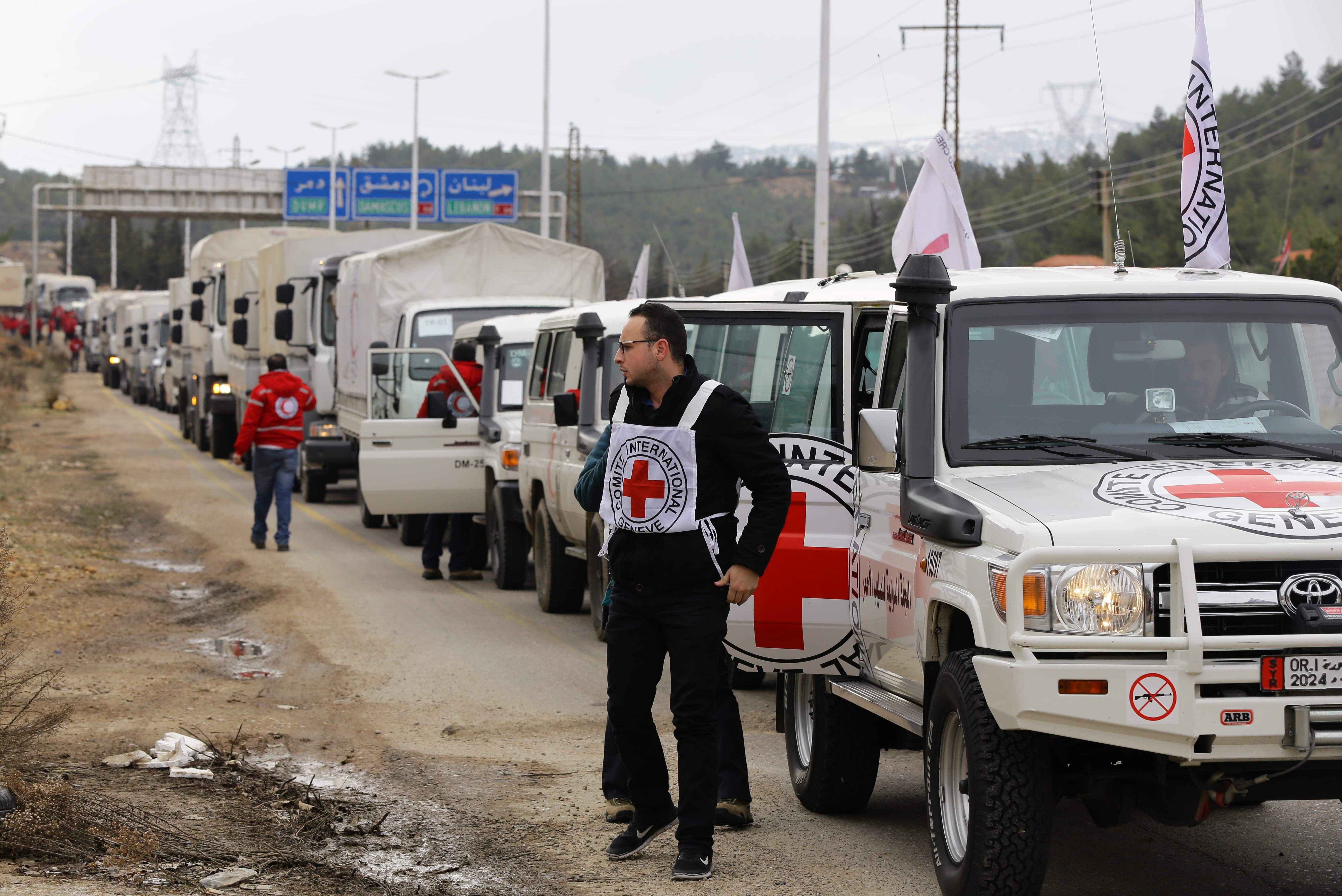 A convoy of aid from the International Committee of the Red Cross (ICRC) waits on the outskirts of the besieged rebel-held Syrian town of Madaya, on Jan. 11, 2016.
