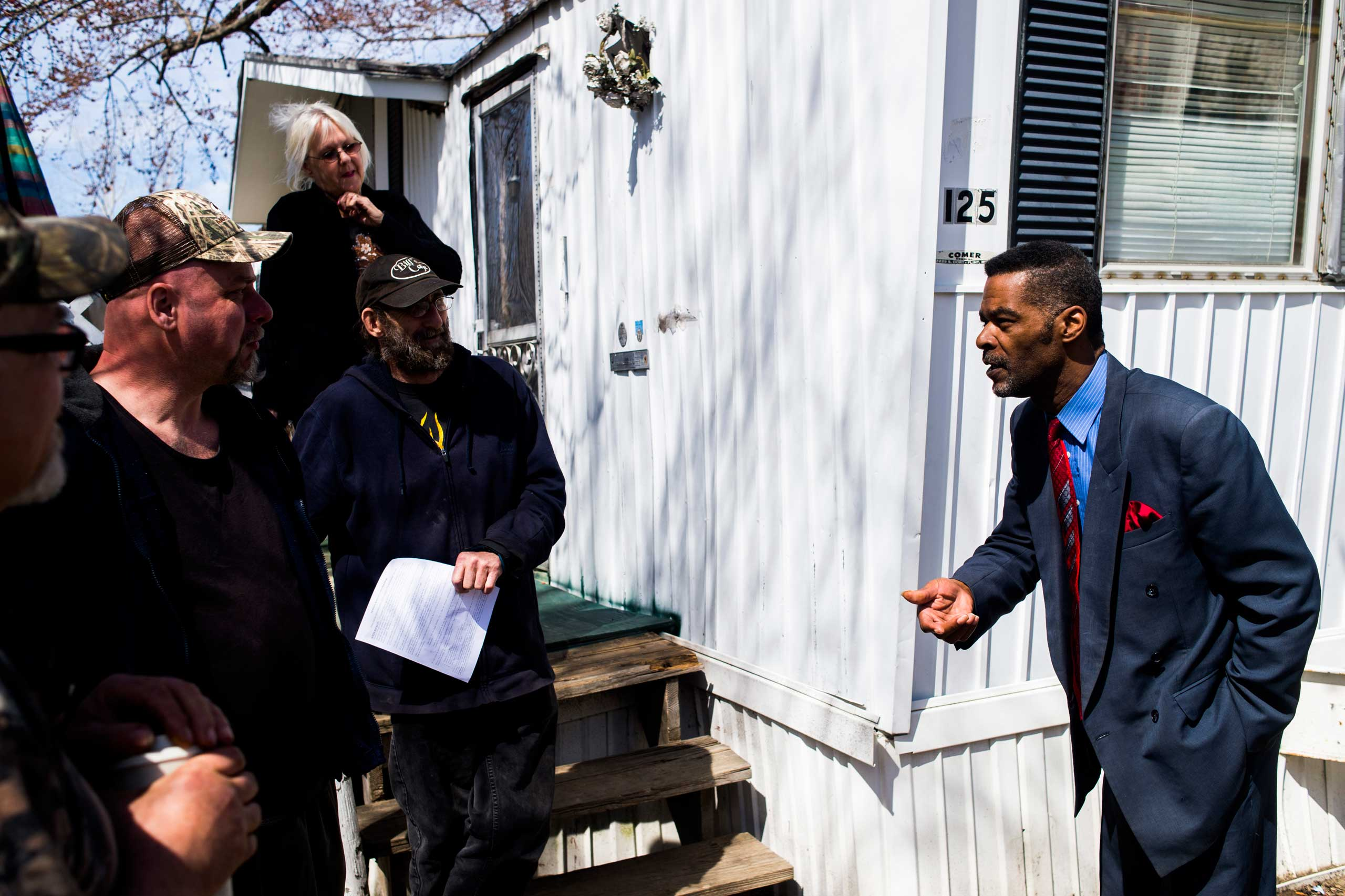 Flint City councilman Eric Mays speaks with concerned residents at Ambassador East mobile home park on April 15, 2015, in Flint, Mich. The city of Flint plans to install a $1.5 million granulated active-charcoal filter by mid-July in an effort to address concerns over its water quality.