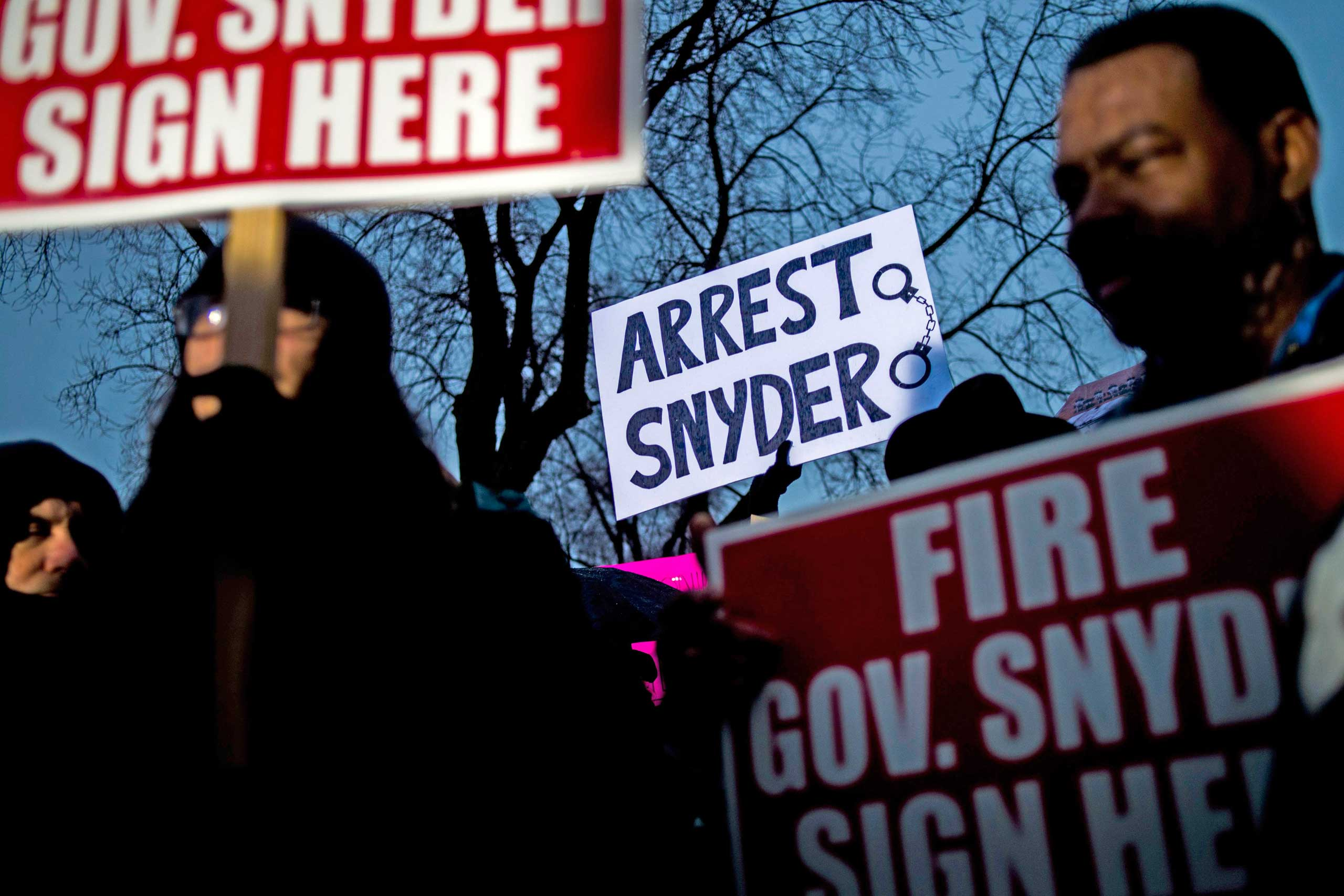 More than 150 activists stand outside of City Hall to protest Michigan Gov. Rick Snyder's handling of the water crisis, Jan. 8, 2016 in Flint. Mich.