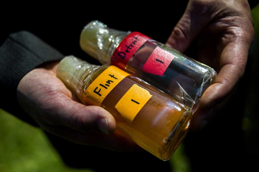 Virginia Tech professor Marc Edwards shows the difference in water quality between Detroit and Flint after testing, giving evidence after more than 270 samples were sent in from Flint that show high levels of lead during a news conference on Sept. 15, 2015 outside of City Hall in downtown Flint, Mich.