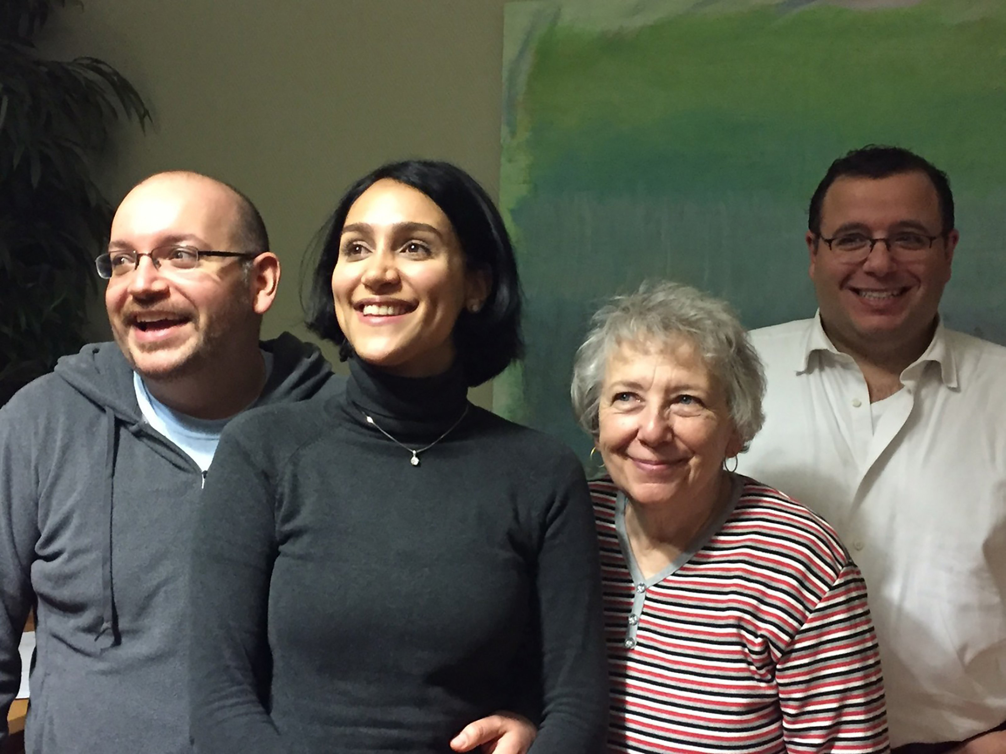 Washington Post journalist Jason Rezaian (left), freed after 18 months of incarceration in an Iranian prison, reunites with his wife Yeganeh Salehi, mother Mary Rezaian and brother Ali Rezaian, on Jan. 18, 2016.