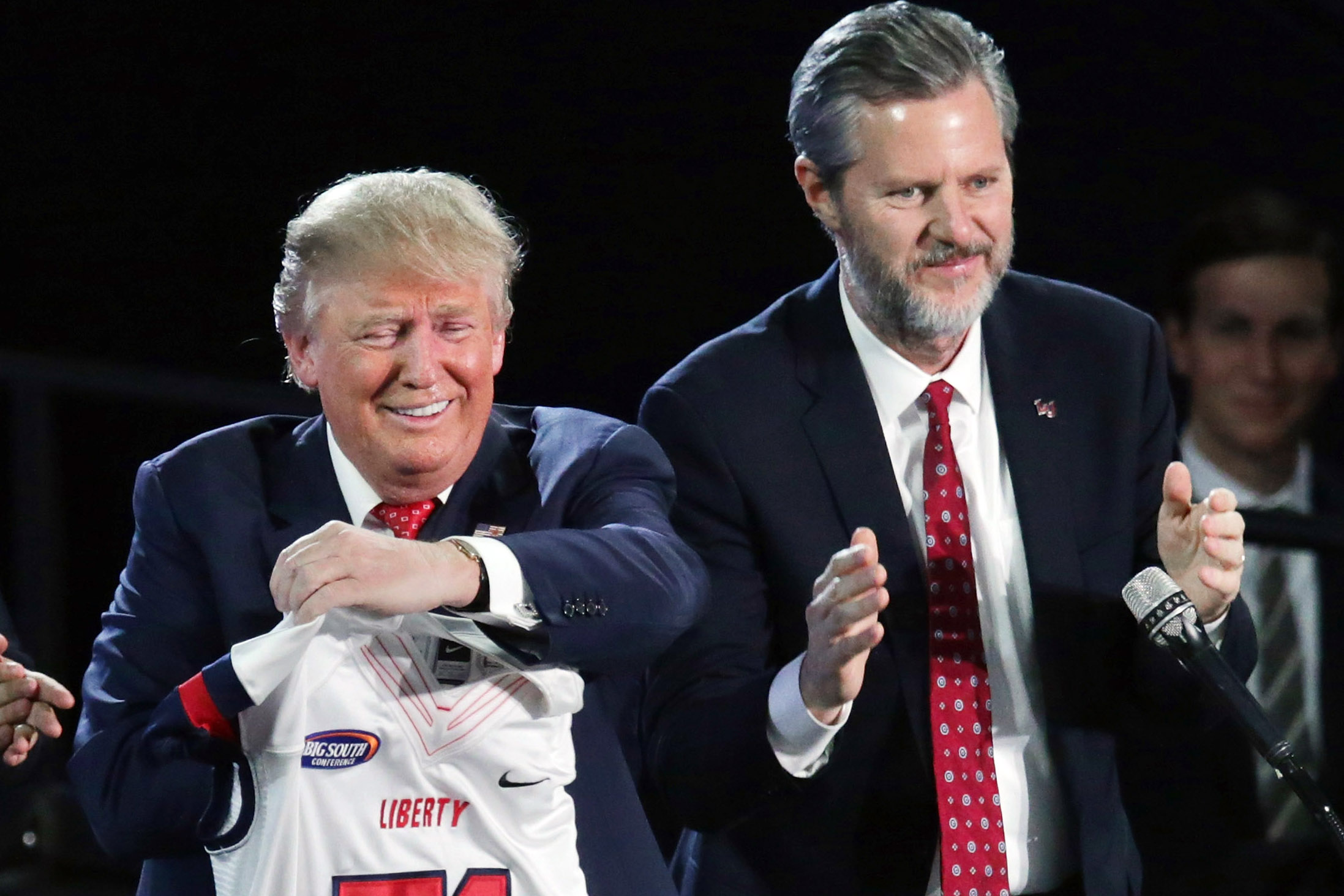Jerry Falwell, Jr. presents Republican presidential candidate Donald Trump with a sports jersey after he delivered the convocation on Jan. 18, 2016 in Lynchburg, Va.
