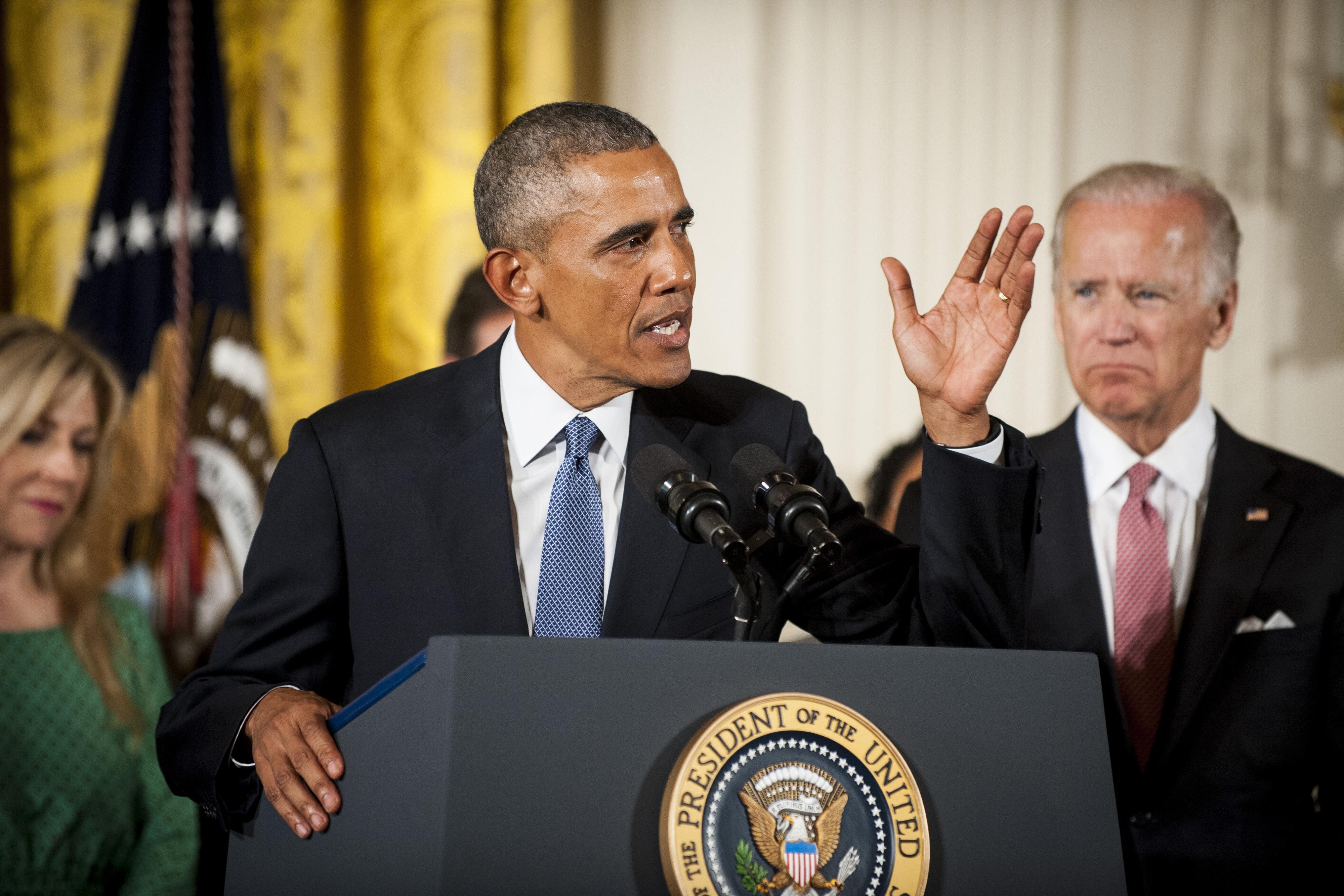 Vice President Joe Biden looks on as President Barack Obama announces his executive action on gun control on Jan. 5.