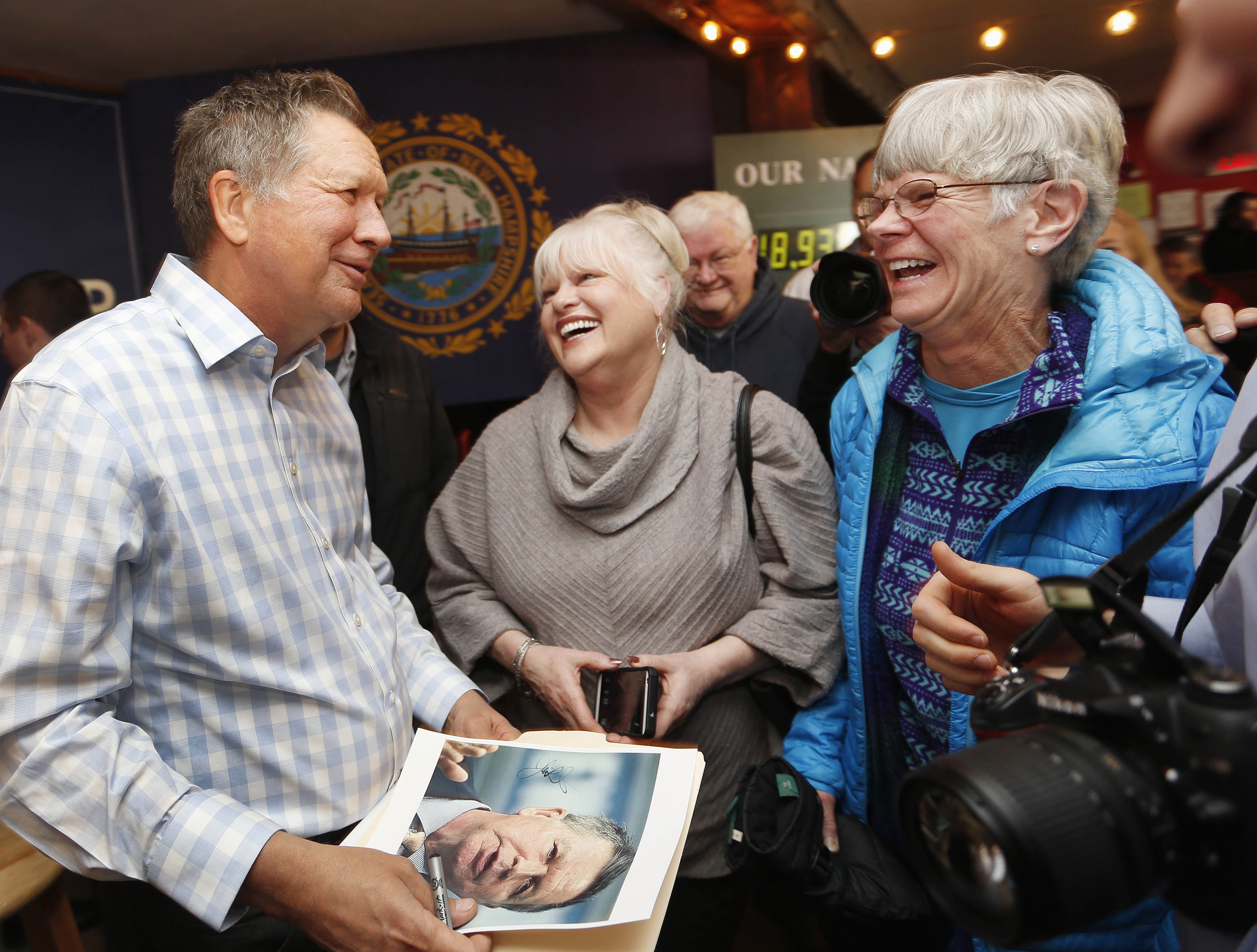 Republican presidential candidate and Ohio Governor John Kasich speaks to voters during a campaign stop at a music-club tavern called the Stone Church on Jan. 25, 2016, in Newmarket, N.H.