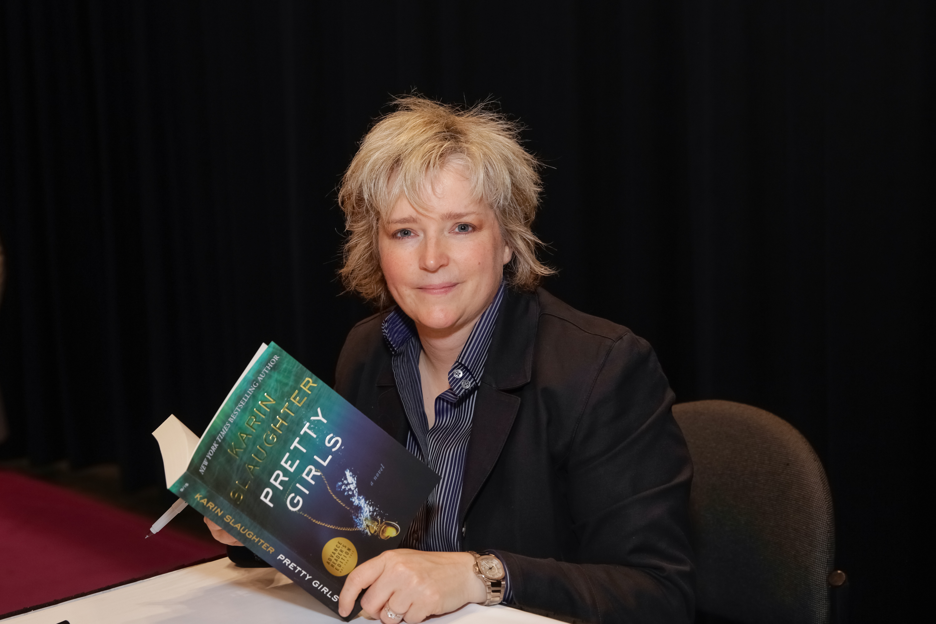 Author Karin Slaughter poses for photographs with her newest book during BookExpo America  in New York City on May 27, 2015.