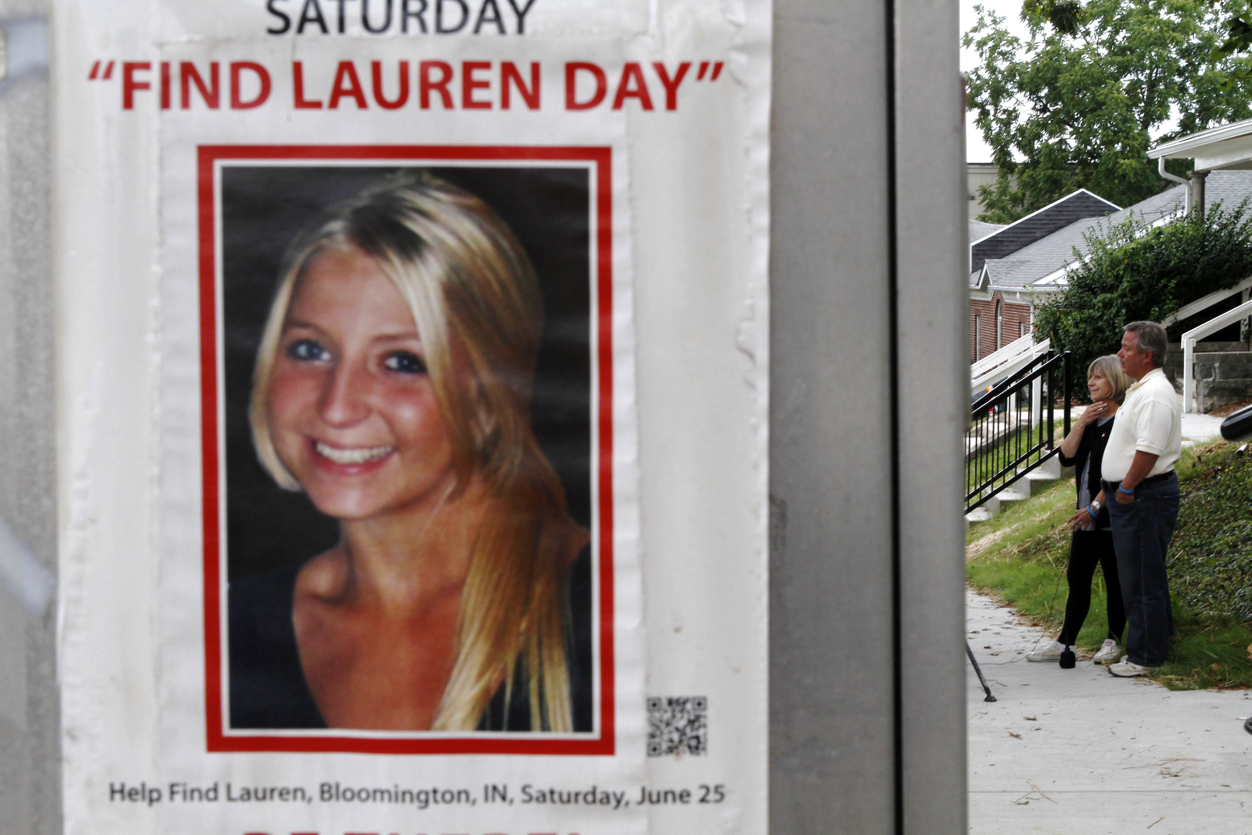 Charlene and Robert Spierer speak to reporters near a poster alerting people to their missing daughter, Lauren, in Bloomington, Ind. on Aug. 15, 2011