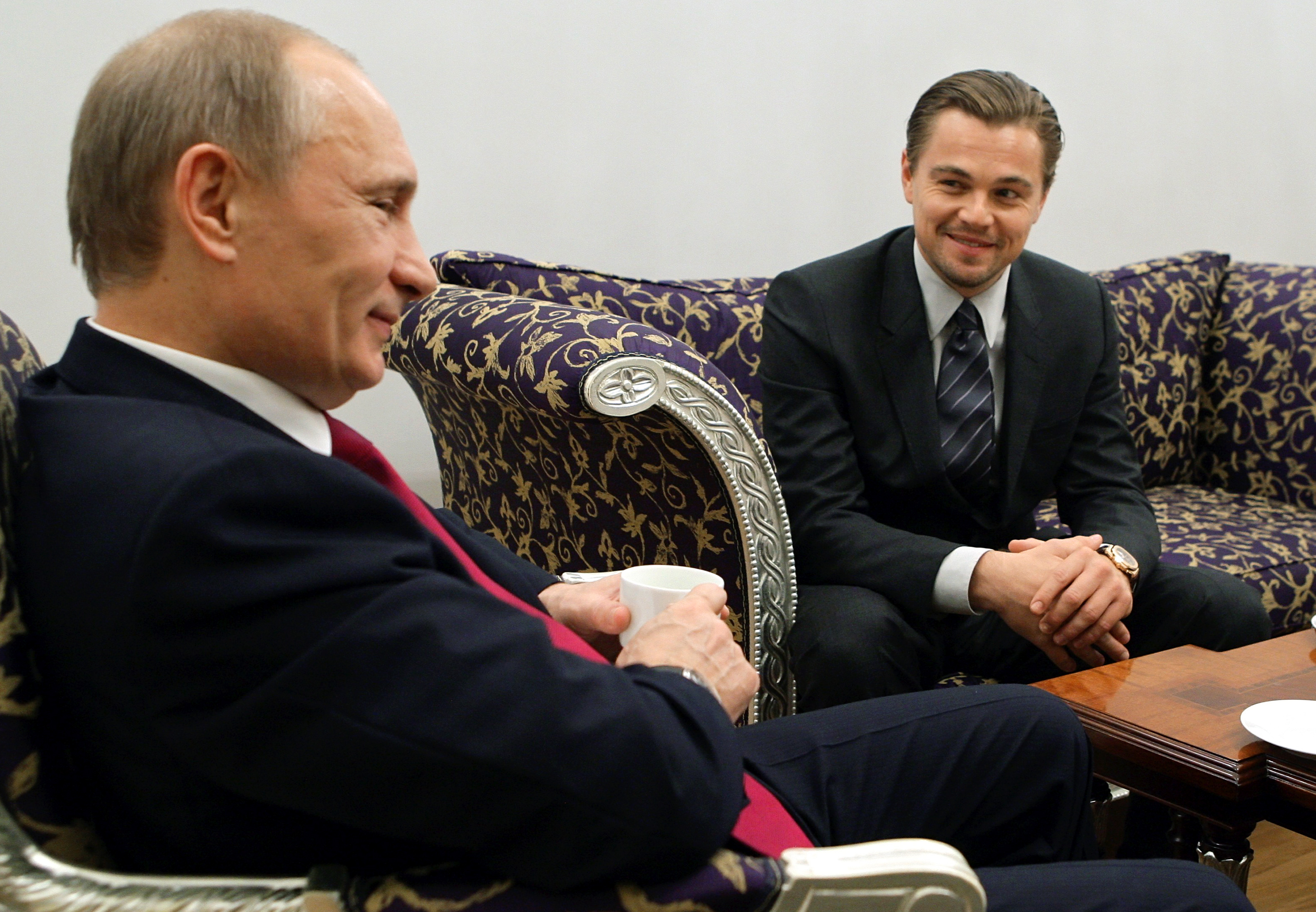 Russia's Prime Minister Vladimir Putin (L) speaks with Leonardo DiCaprio after a concert to mark the International Tiger Conservation Forum at the Mikhailovsky theater in Saint Petersburg on Nov. 23, 2010.