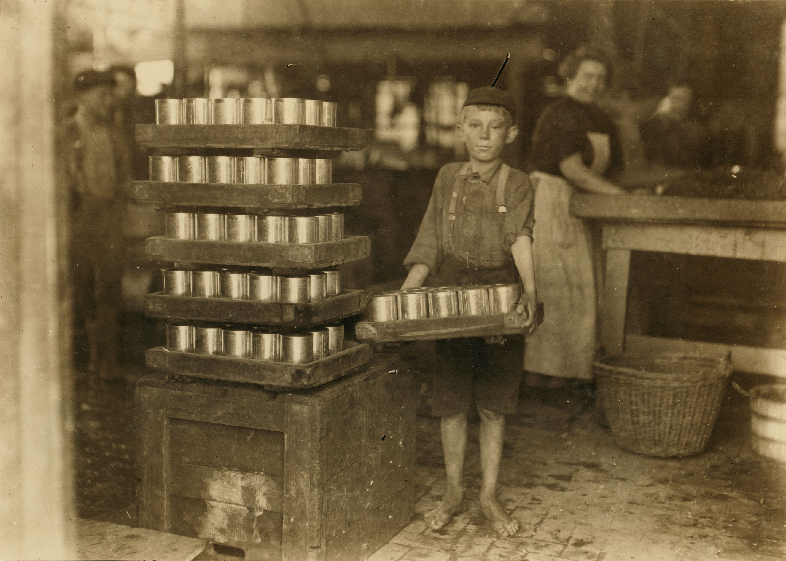 One of the small boys in J. S. Farrand P[ac]king Co. and a heavy load. J. W. Magruder, witness. July 1909.  Baltimore, Maryland.