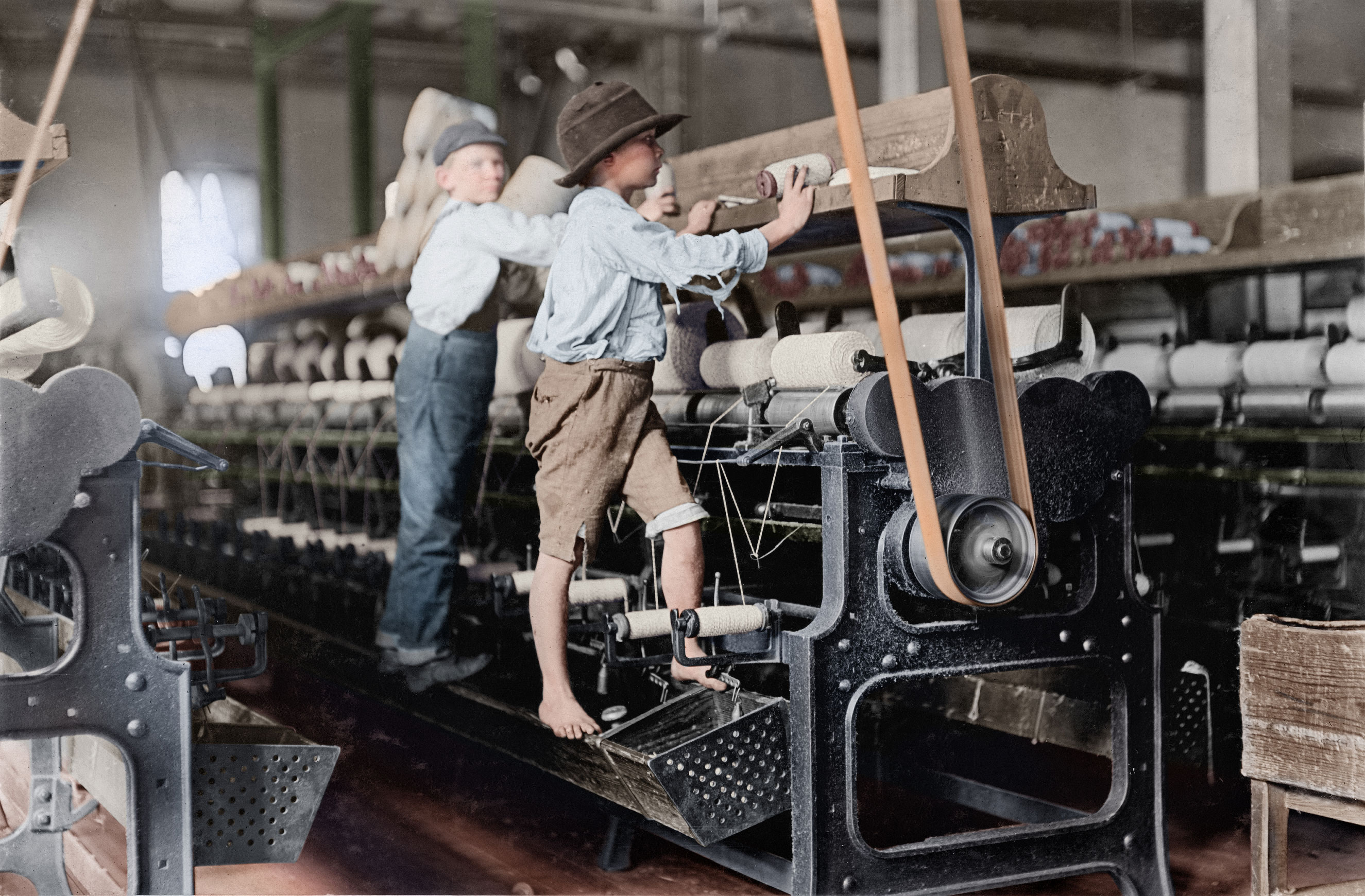 Bibb Mill No. 1 Many youngsters here. Some boys were so small they had to climb up on the spinning frame to mend the broken threads and put back the empty bobbins. Jan. 1909. Macon, Georgia.