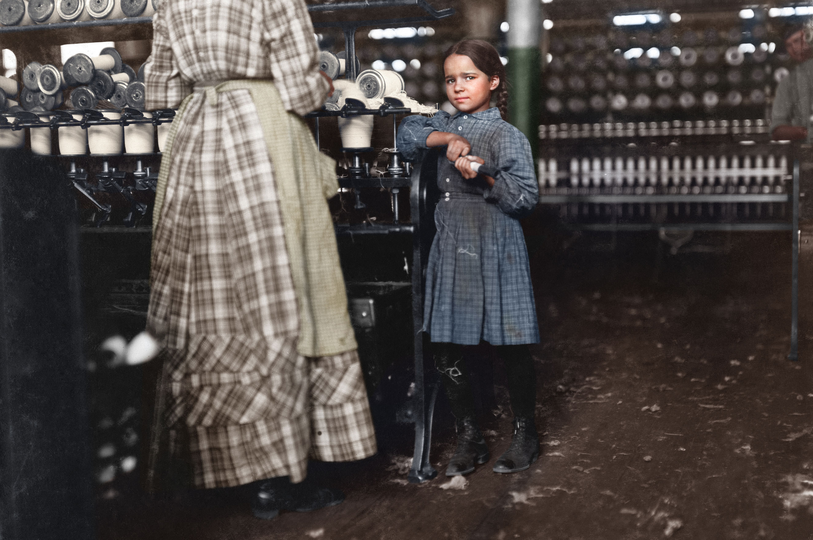 Little Fannie, 7 years old, 48 inches high, helps sister in Elk Mills. Her sister (in photo) said,  Yes, she he'ps me right smart. Not all day but all she can. Yes, she started with me at six this mornin'.  These two belong to a family of 19 children. Nov. 1910. Fayetteville, Tennessee.