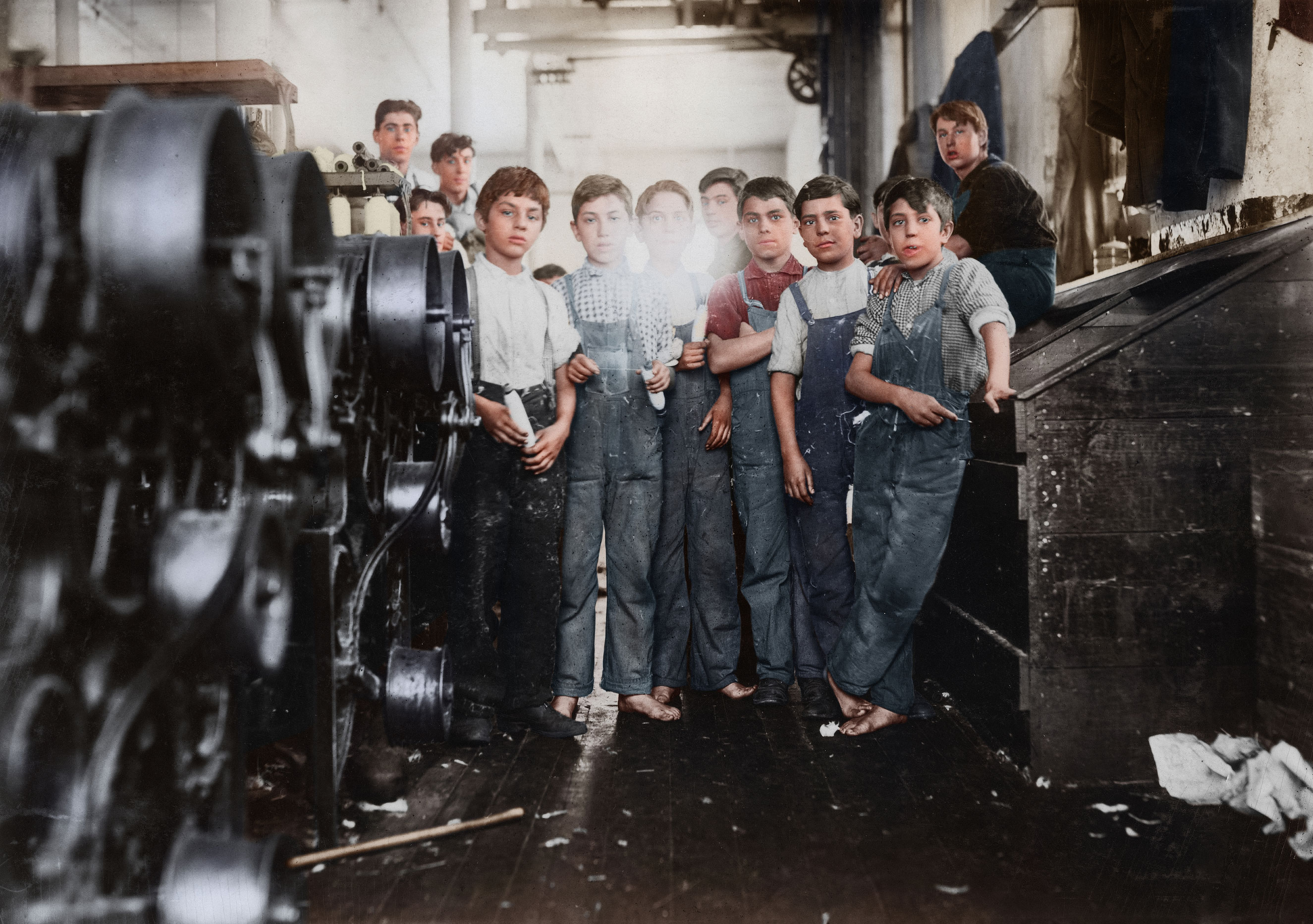 Young doffer and spinner boys in Seaconnet Mill. The youngest are Manuel Perry, 111 Pitman St. John E. Mello, 229 Alden St. Manuel Louis. None of these could write their own names. The last couldn't spell the street he lives on. They spoke almost no English. Jan. 1912. Fall River, Massachusetts.