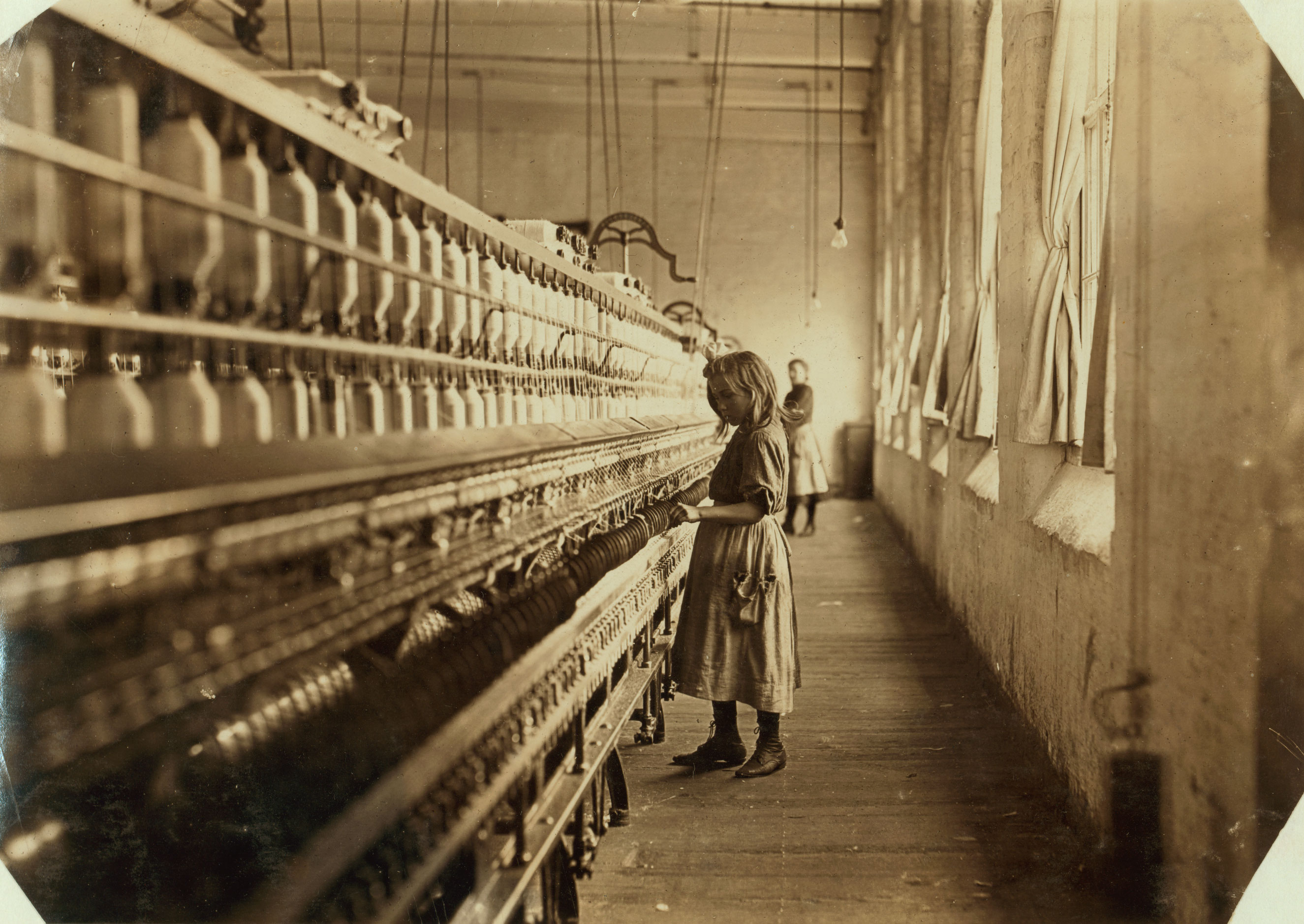 Sadie Pfeifer, 48 inches high, has worked half a year. One of the many small children at work in Lancaster Cotton Mills. Nov. 1908. Lancaster, South Carolina.