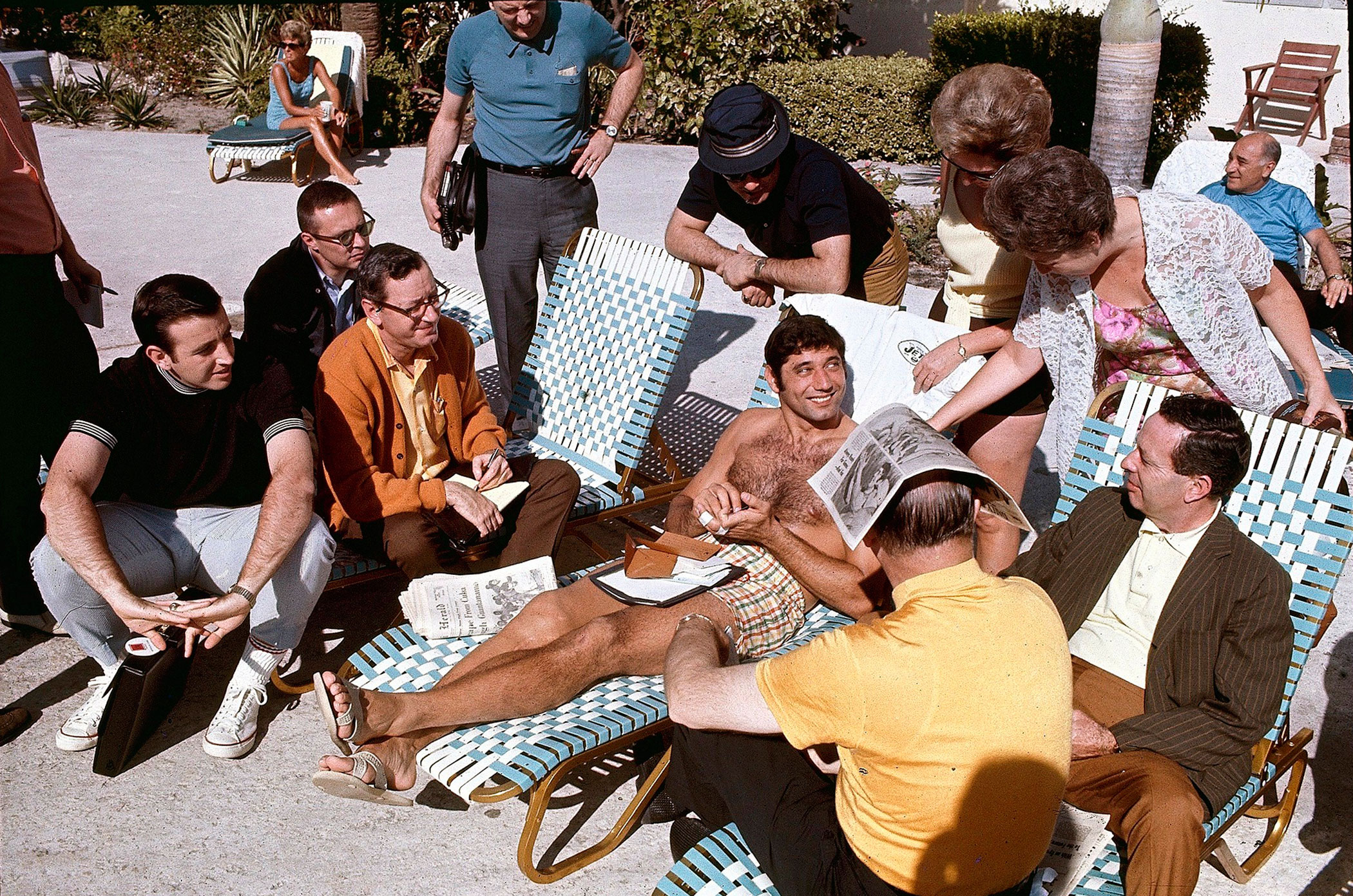 Super Bowl III, Jan. 10, 1969                               New York Jets vs. Baltimore Colts in Miami                               Joe Namath sits poolside with press and fans before the game.