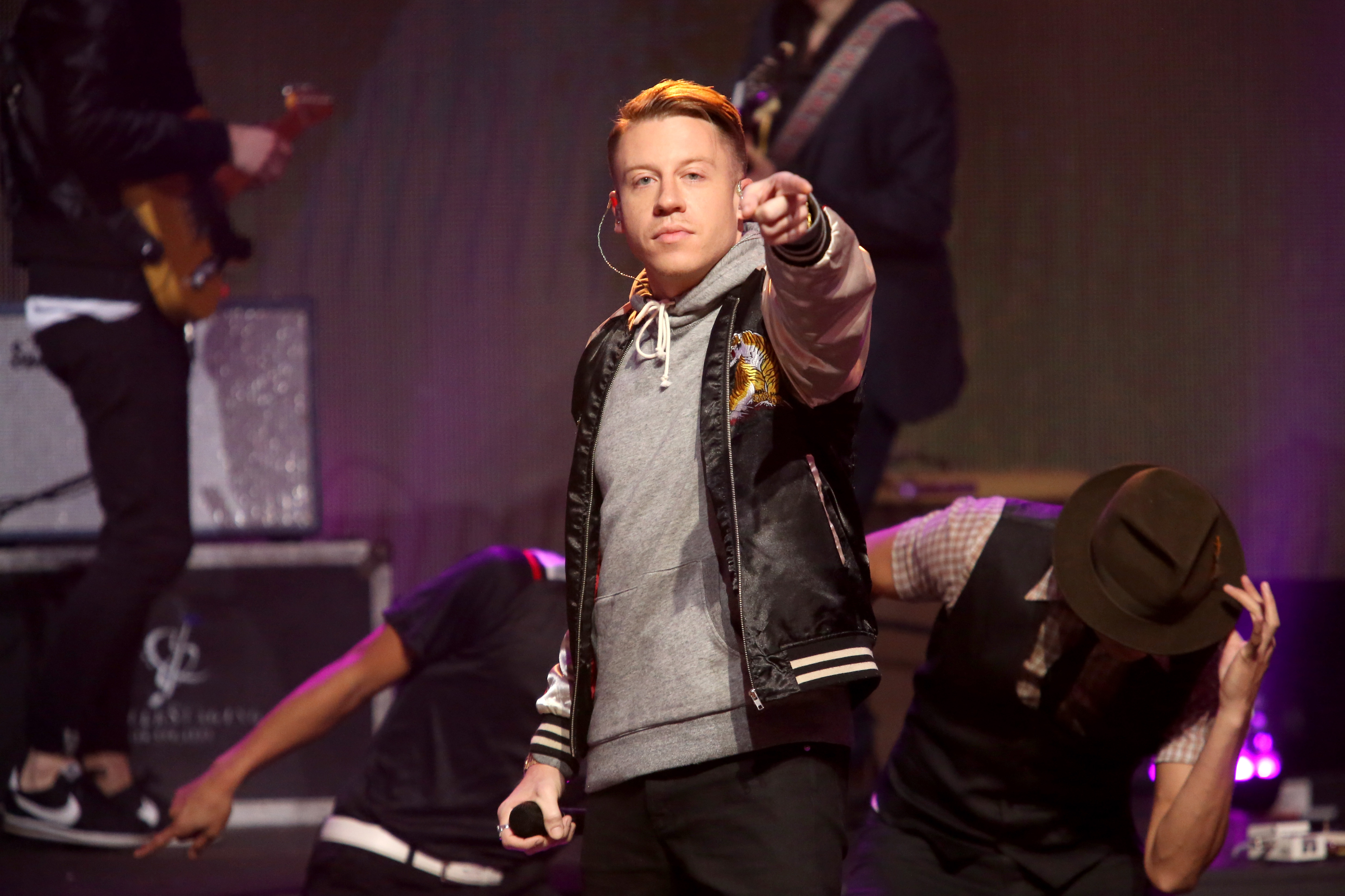 Macklemore performs onstage at Dick Clark's New Year's Rockin' Eve with Ryan Seacrest 2016 on December 31, 2015 in Los Angeles, CA.
