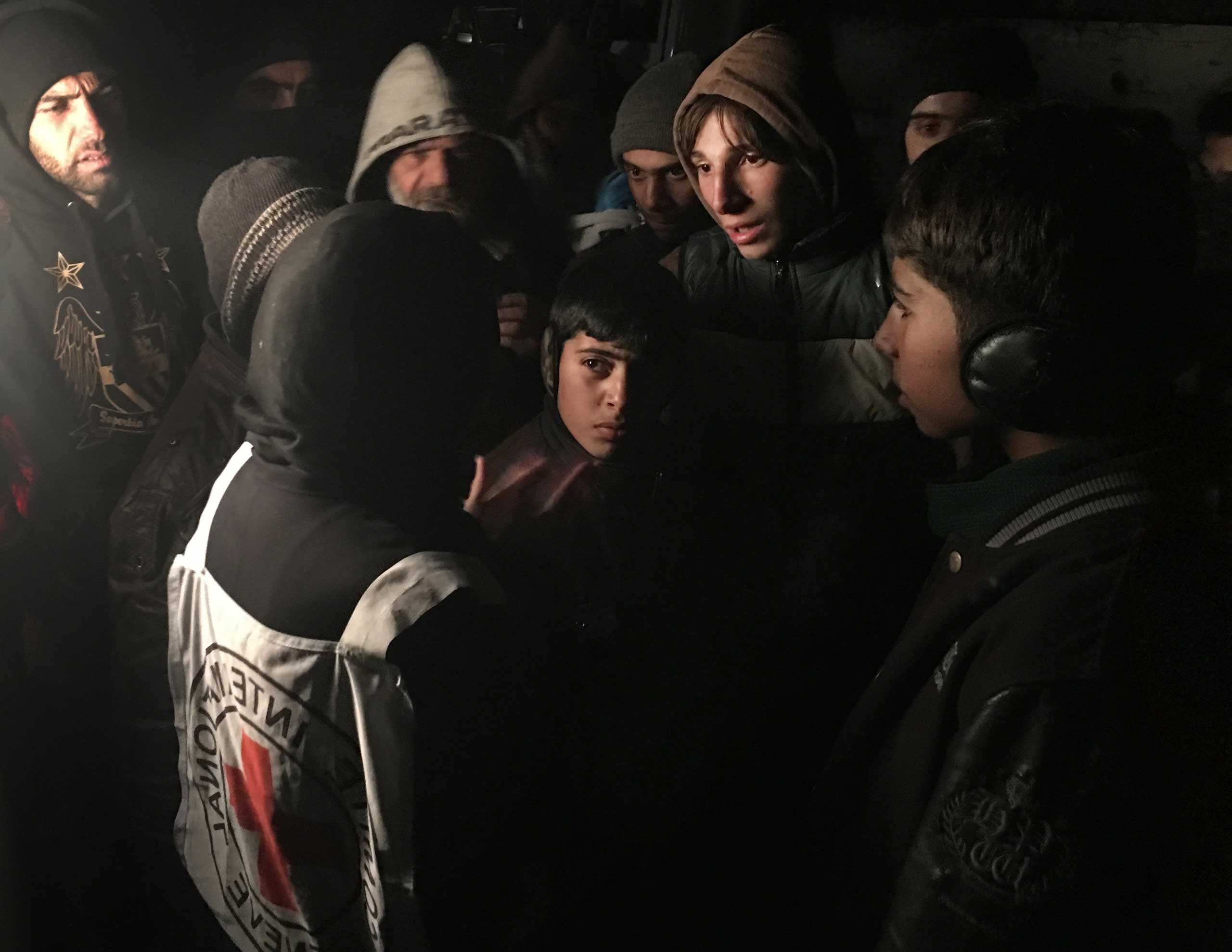 ICRC Head of Delegation Marianne Gasser speaks to residents of Madaya, a besieged town in Syria, as they gather around an aid convoy, Jan. 11, 2016. The International Committee of the Red Cross, working alongside the Syrian Arab Red Crescent and United Nations, began to deliver aid to thousands of people living in three besieged areas in Syria.