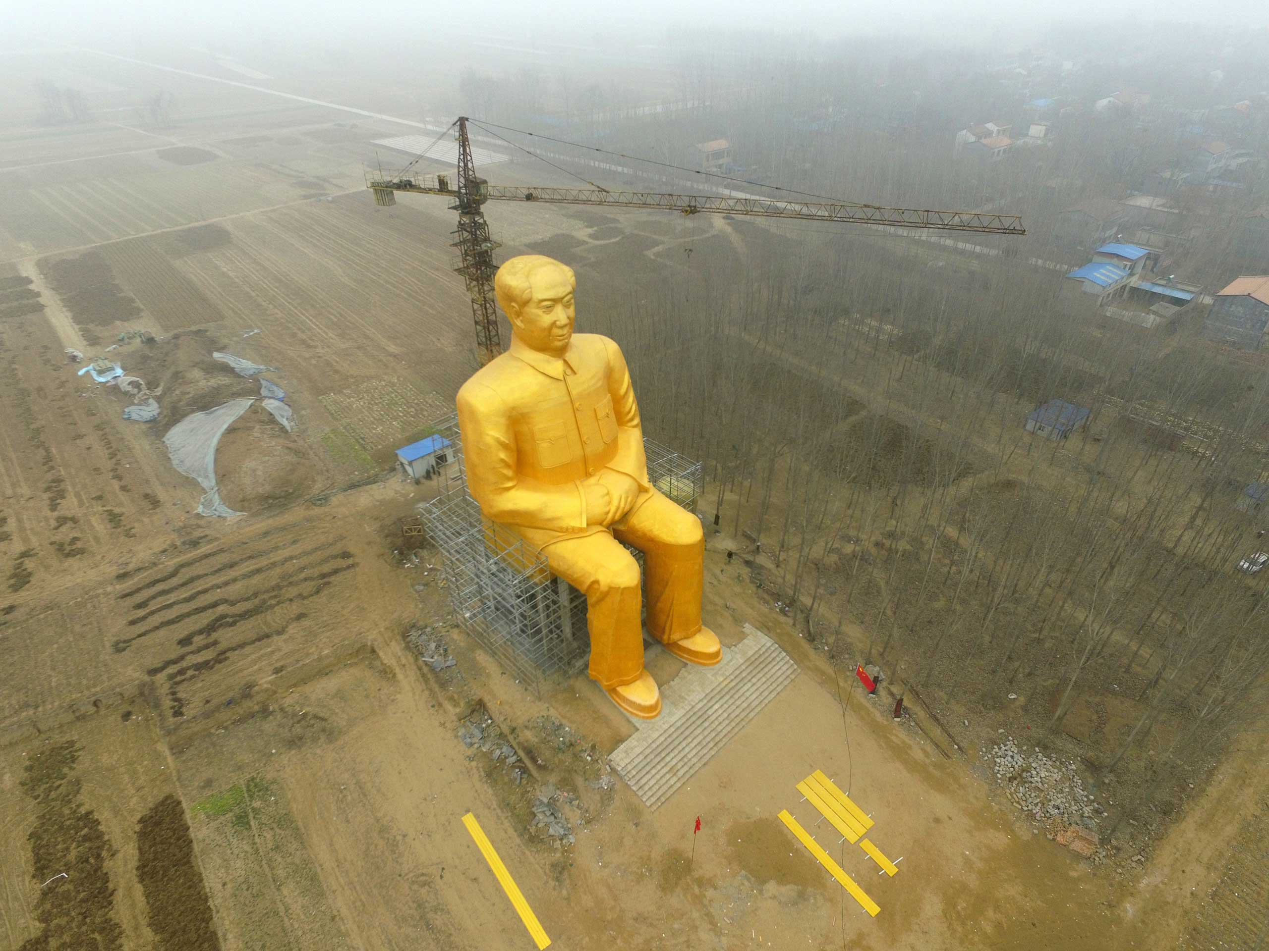 A huge statue of Chairman Mao Zedong, 36.6 meters in height, is seen under construction at Zhushigang village in Tongxu County, China, on Jan. 4.