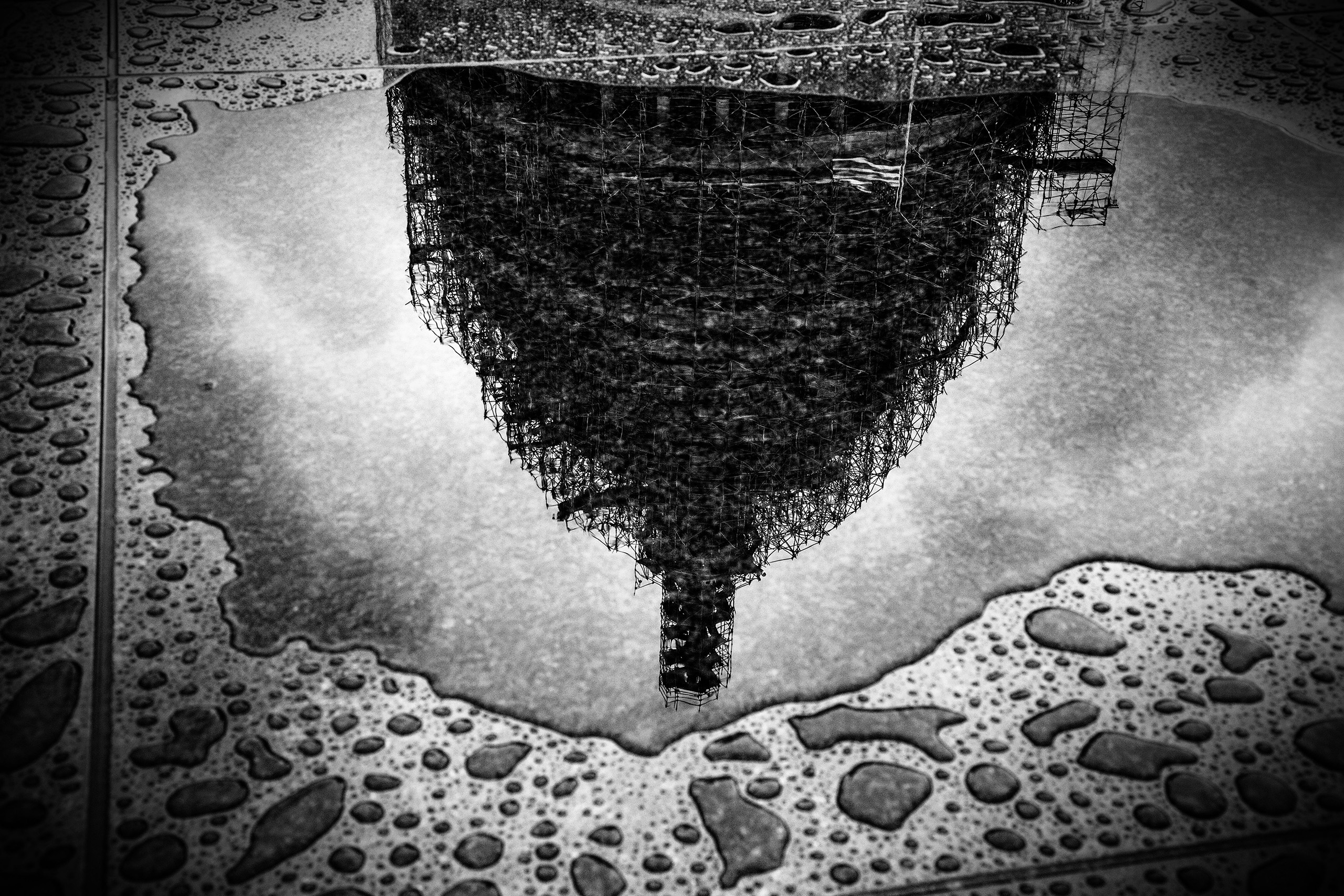 U.S. Capitol Dome under repair reflected in a puddle, in Washington D.C., Sept. 30, 2015.