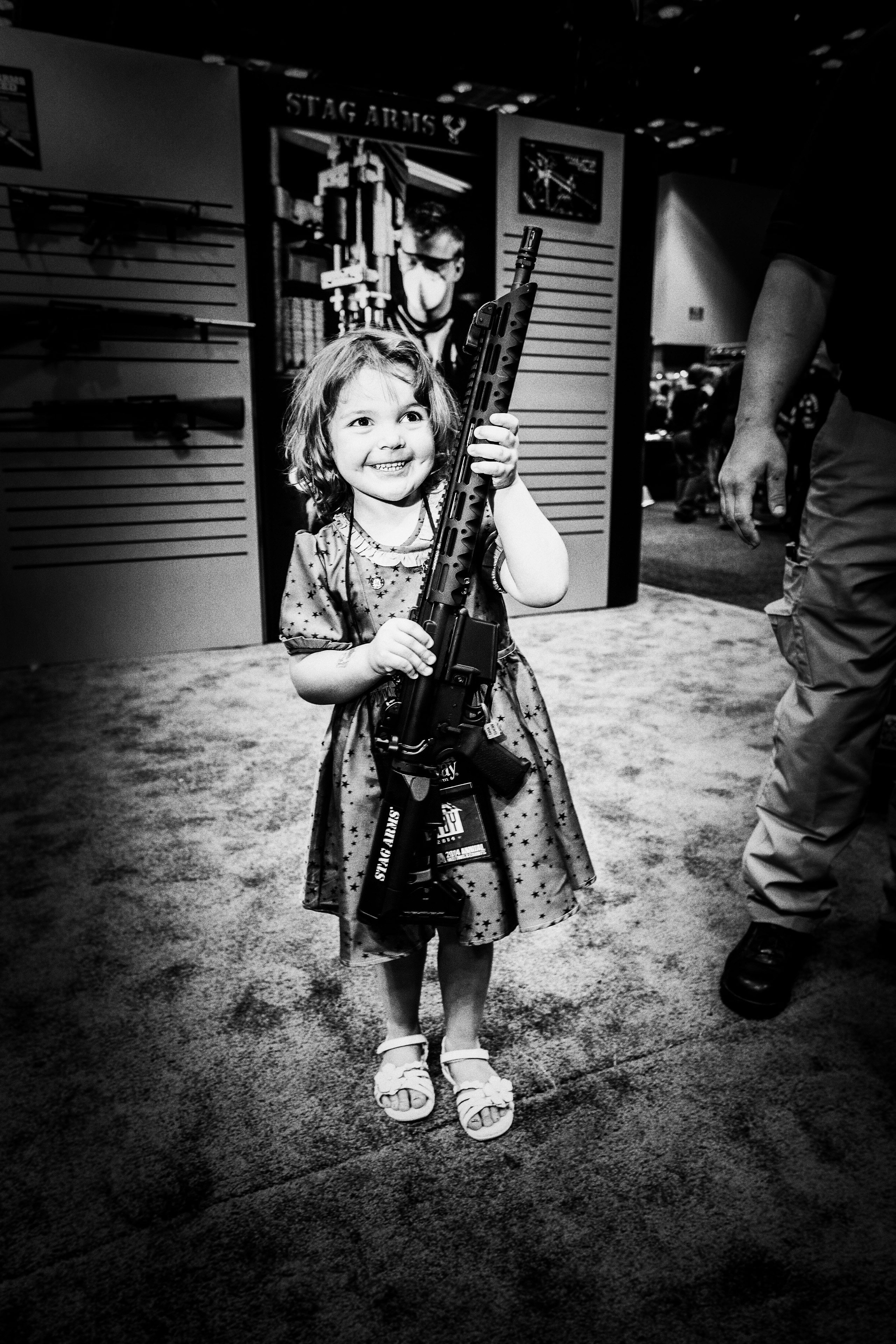 Four-year-old Violet Ogle with a assault rifle at the National Rifle Association's annual convention in Indianapolis, In.