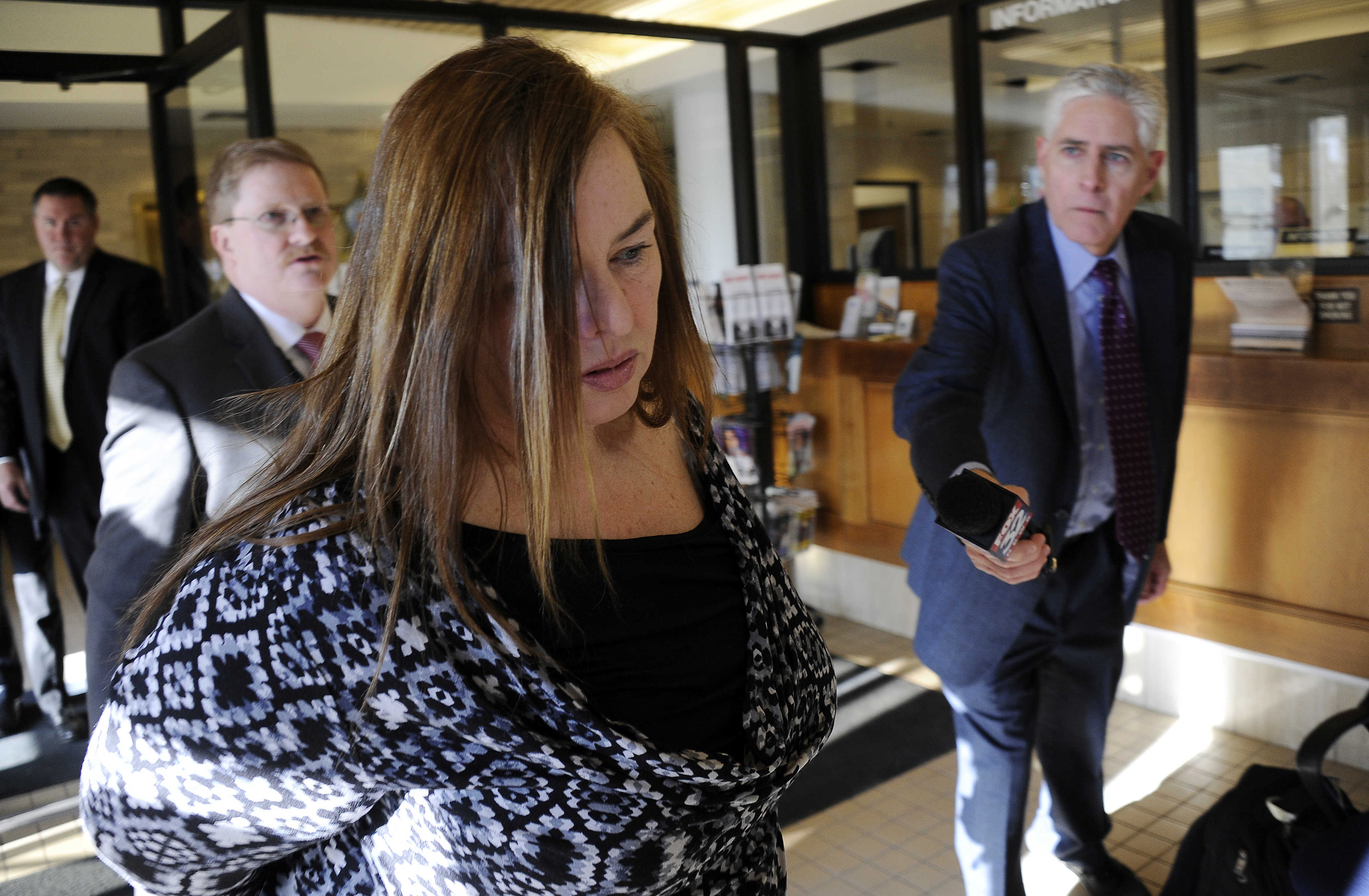 Melodie Gliniewicz, 51, of Antioch,Ill.,  appearars at the Lake County sheriff's office after she was indicted in Waukegan, Ill., by a Lake County grand jury.