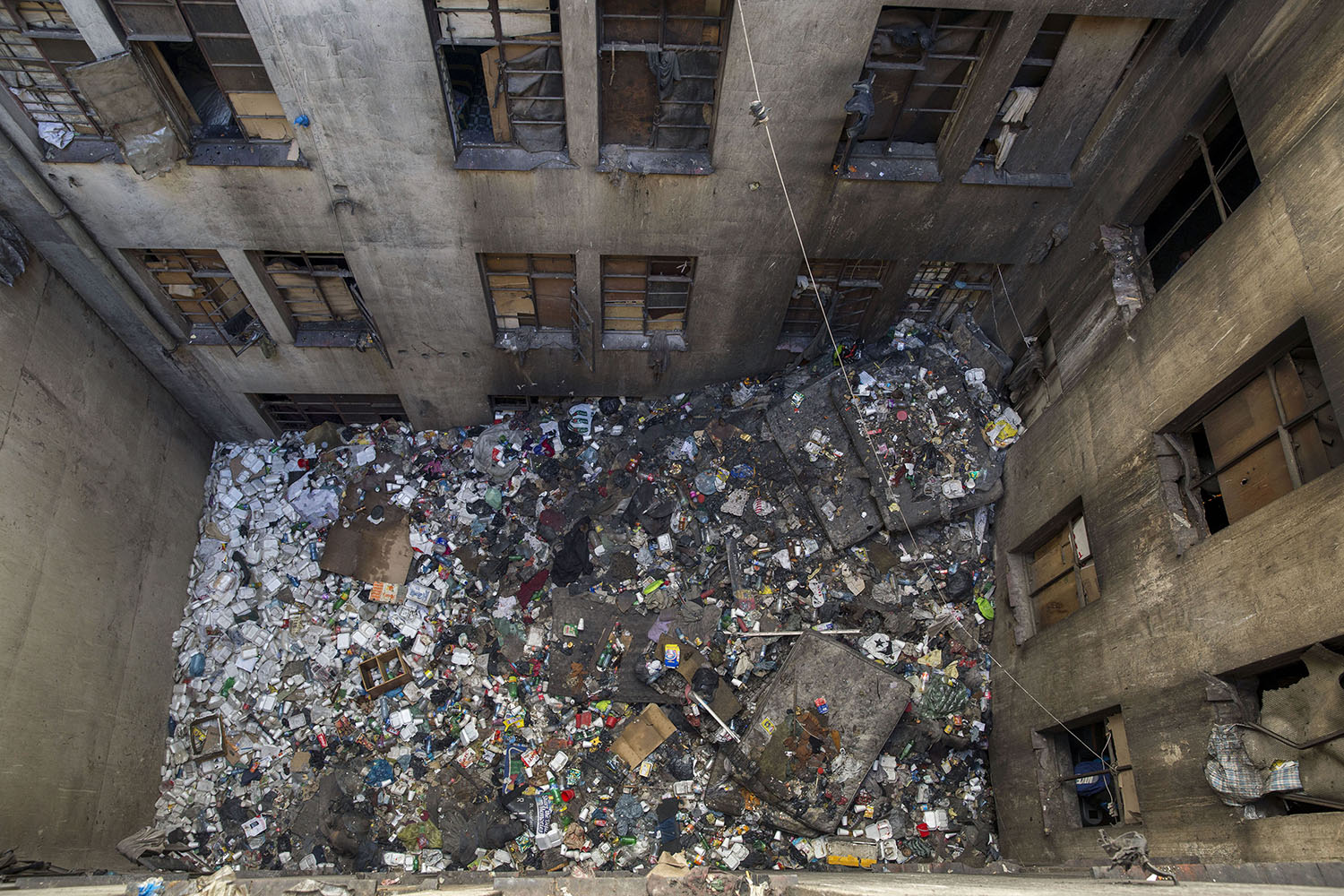 Aerial view of the rubbish-filled courtyard at one of the derelict 'hijacked' buildings, Aug. 2, 2015.