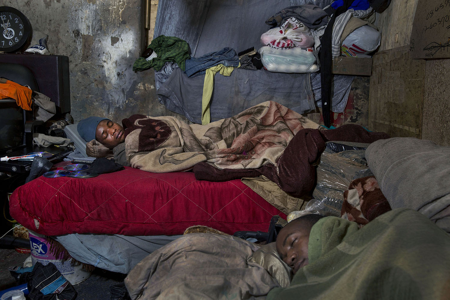 African migrants from Zimbabwe sleep in tight quarters, July 12, 2015.