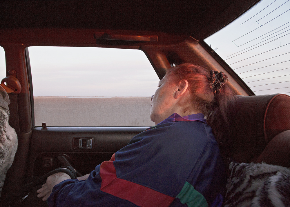 A woman on the way to Petrovka, Russia, 2013. Forty years have passed since she left the village.