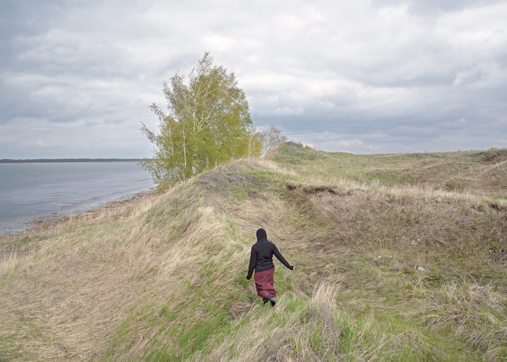 A woman, 24, at the Crooked Lake in Petrovka, Omsk Oblast, Russia, 2014.