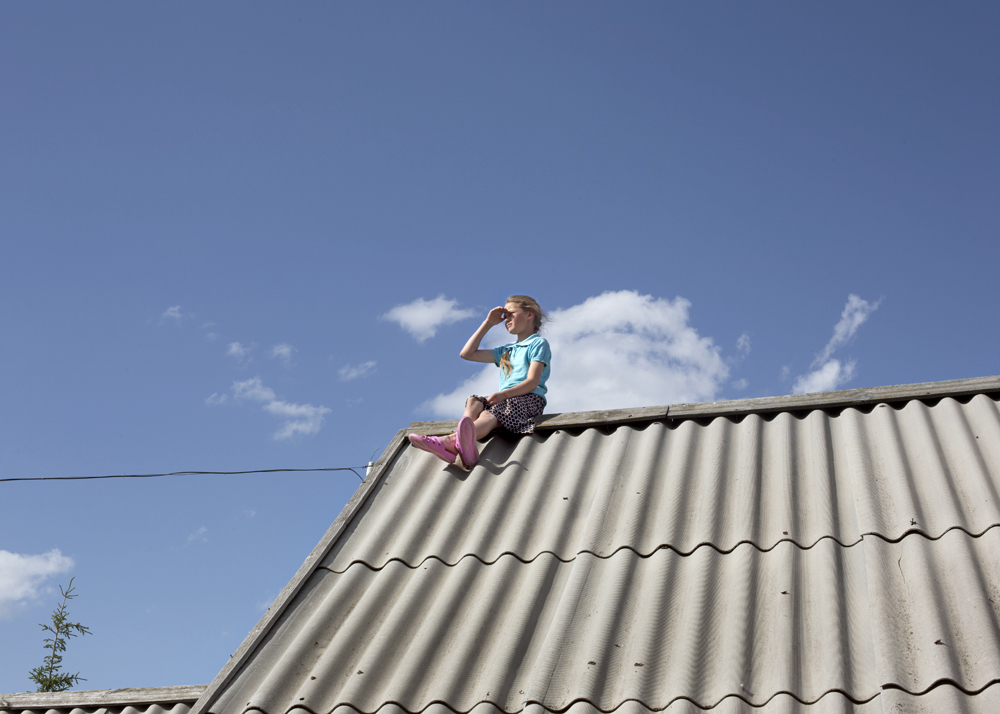 An eleven-year-old on a Tuesday afternoon in Petrovka, Russia, 2014.