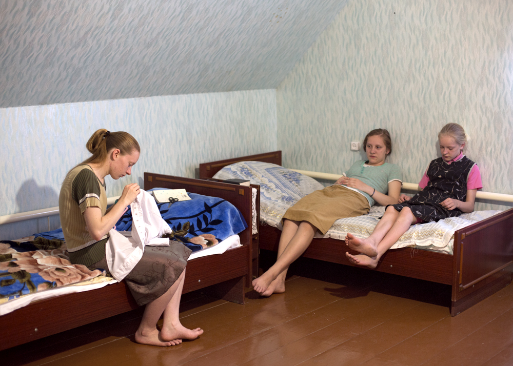 Sisters in their room on a Saturday afternoon in Petrovka, Russia, 2014.