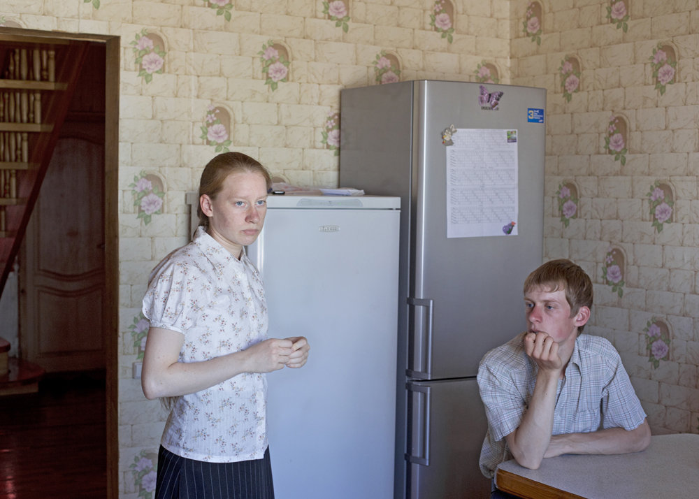 A brother and sister shortly before the final rehearsal, one day before the Sängerfest, or singer festival, a competition of singers or singer groups in Petrovka, Russia, 2014.
