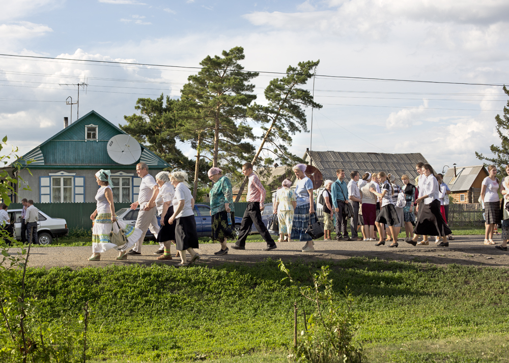 A crowd of Russian Mennonites after a singing festival in the woods of Iwanovka, Russia, 2014.