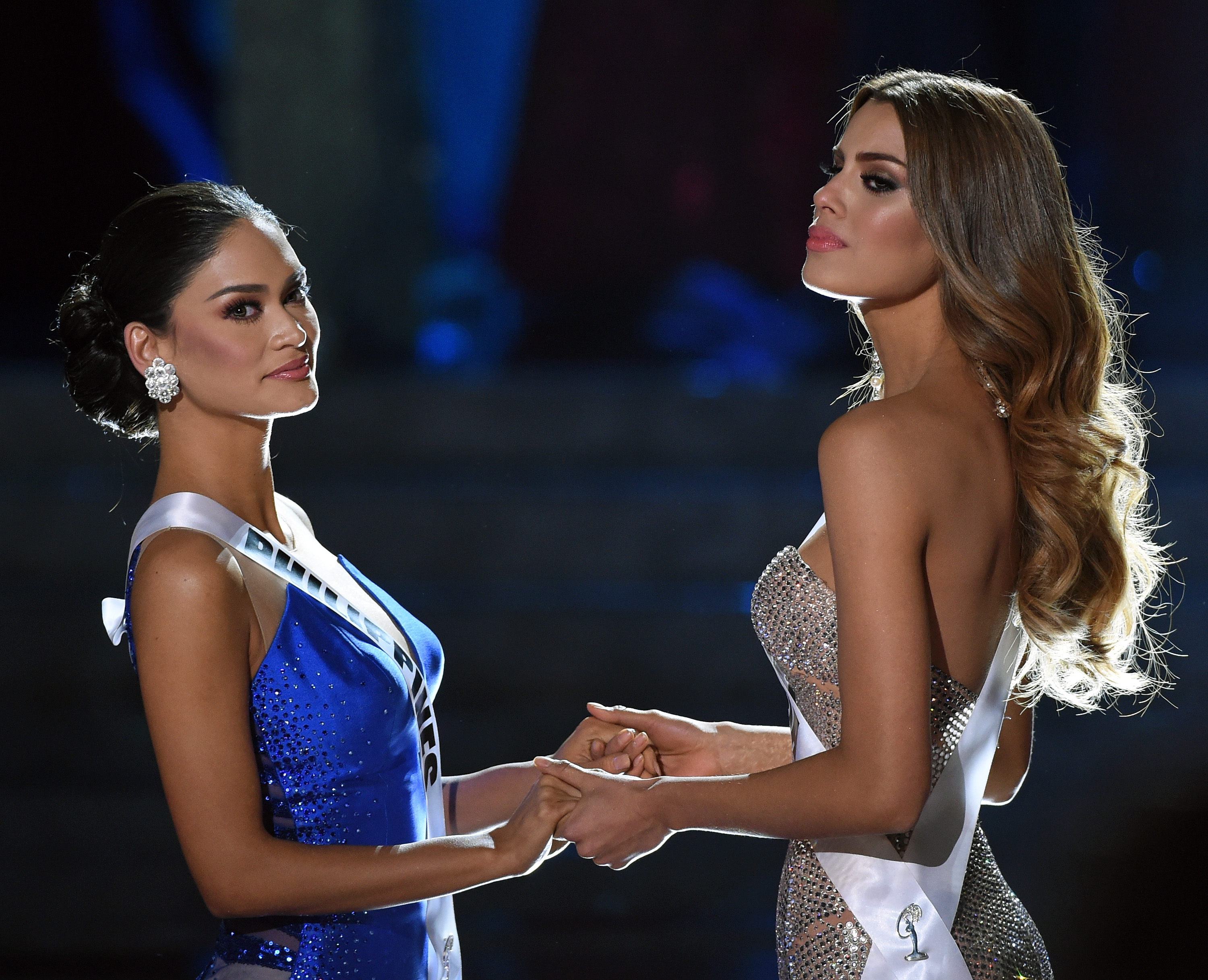 Miss Philippines 2015, Pia Alonzo Wurtzbach (L), and Miss Colombia 2015, Ariadna Gutierrez Arevalo, hold hands as they wait for the judges' final decision in the 2015 Miss Universe Pageant at The Axis at Planet Hollywood Resort & Casino on December 20, 2015 in Las Vegas, Nevada.