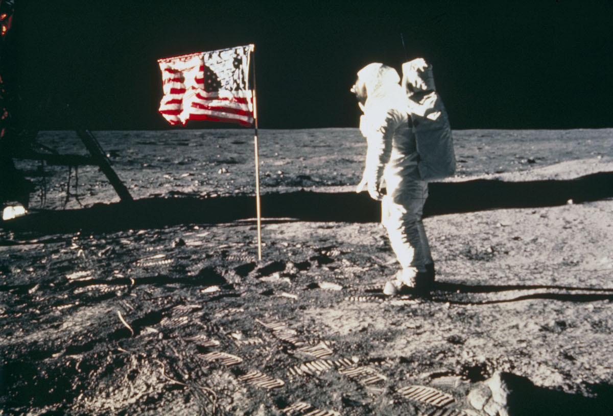 Buzz Aldrin shown standing beside the United States flag during Apollo 11, the first manned lunar landing mission.