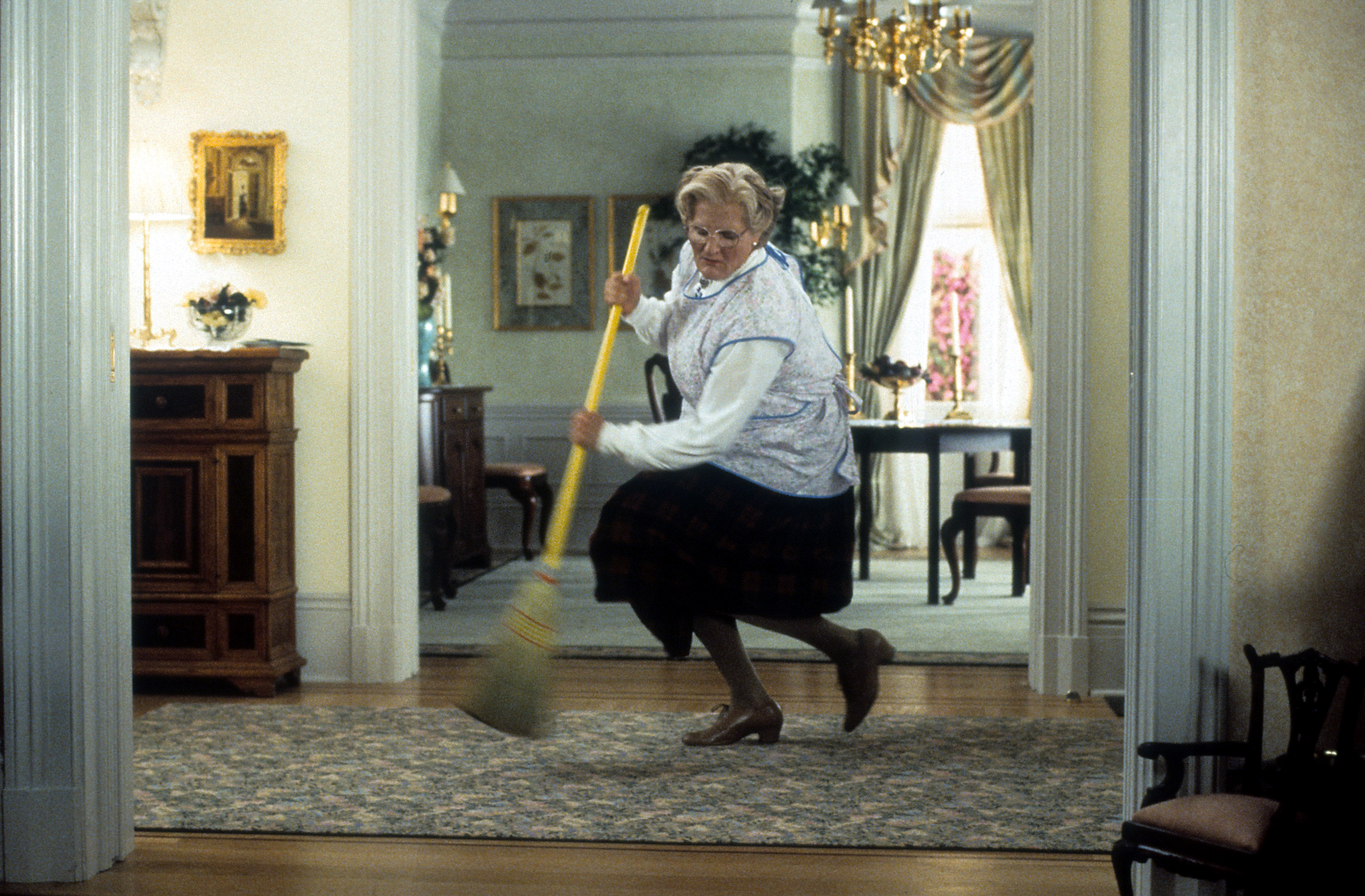 Robin Williams brooms in a scene from the film 'Mrs. Doubtfire', 1993.