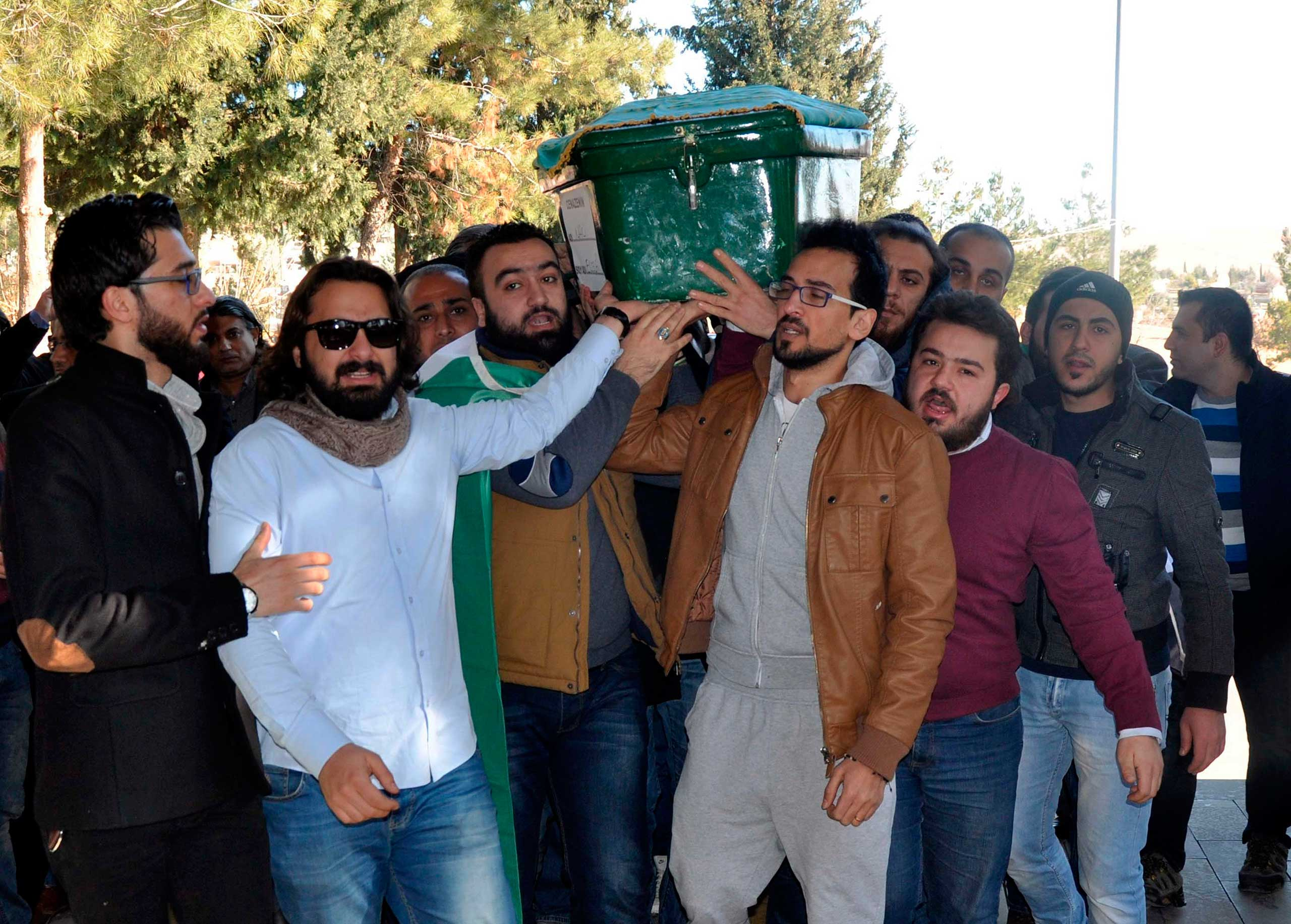 Men carry the coffin of filmmaker Naji Jerf, a citizen journalist with the anti-ISIS activist group Raqqa is Being Slaughtered Silently, who was killed Dec. 27 in Gaziantep, Turkey, on Dec. 28, 2015.
