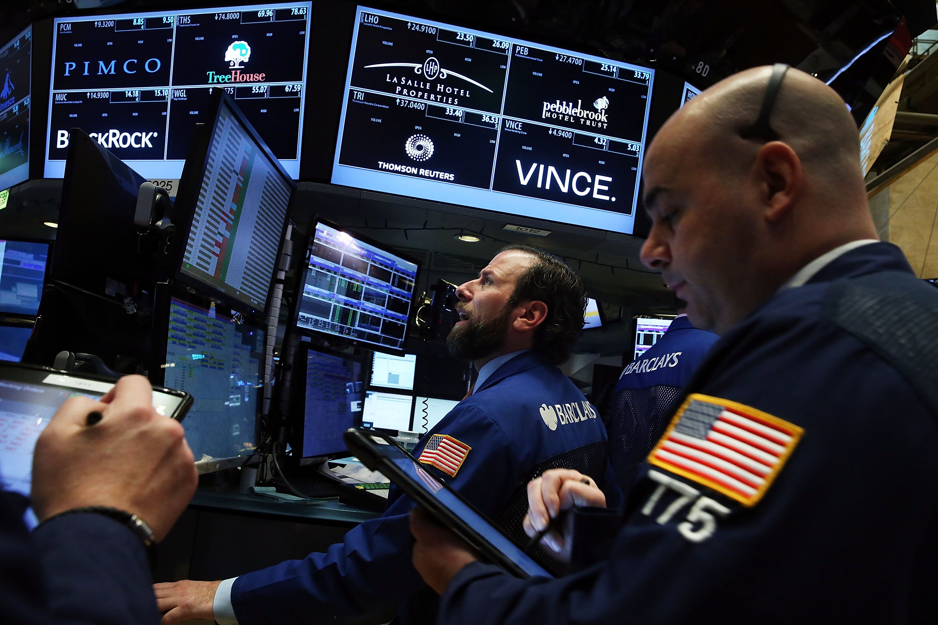 Traders work on the floor of the New York Stock Exchange in New York City on January 6, 2016.