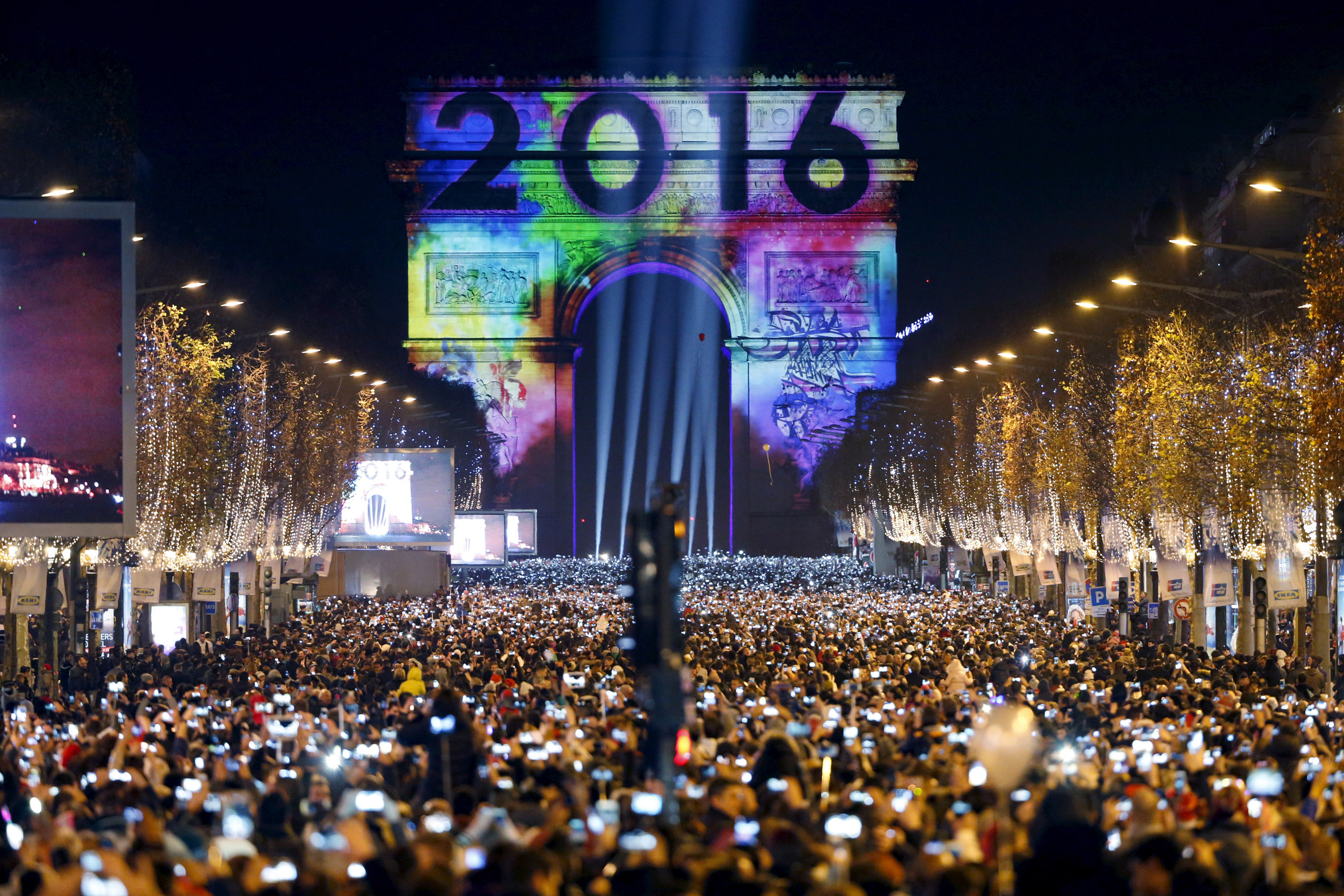 Revellers gather near the Arc de Triomphe on the Champs Elysees during New Year celebrations in Paris on Jan. 1, 2016.