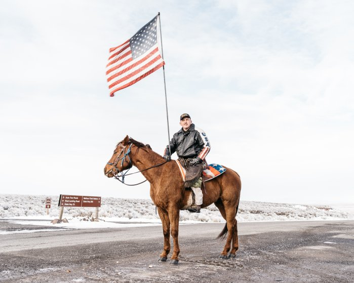 Dwayne Ehmer, of Irrigon, Ore., sits atop his horse Hellboy as they greet media on Jan. 12, 2016, at the entrance to the Malheur National Wildlife Refuge in Harney County, Ore.