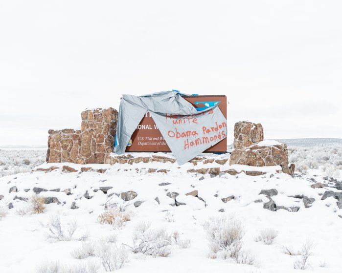 "A sign for the Malheur National Wildlife Refuge along Frenchglenn Highway is draped with a tarp that reads ""Ranchers Unite, Obama Pardon Hammonds"" on Jan. 11, 2016."