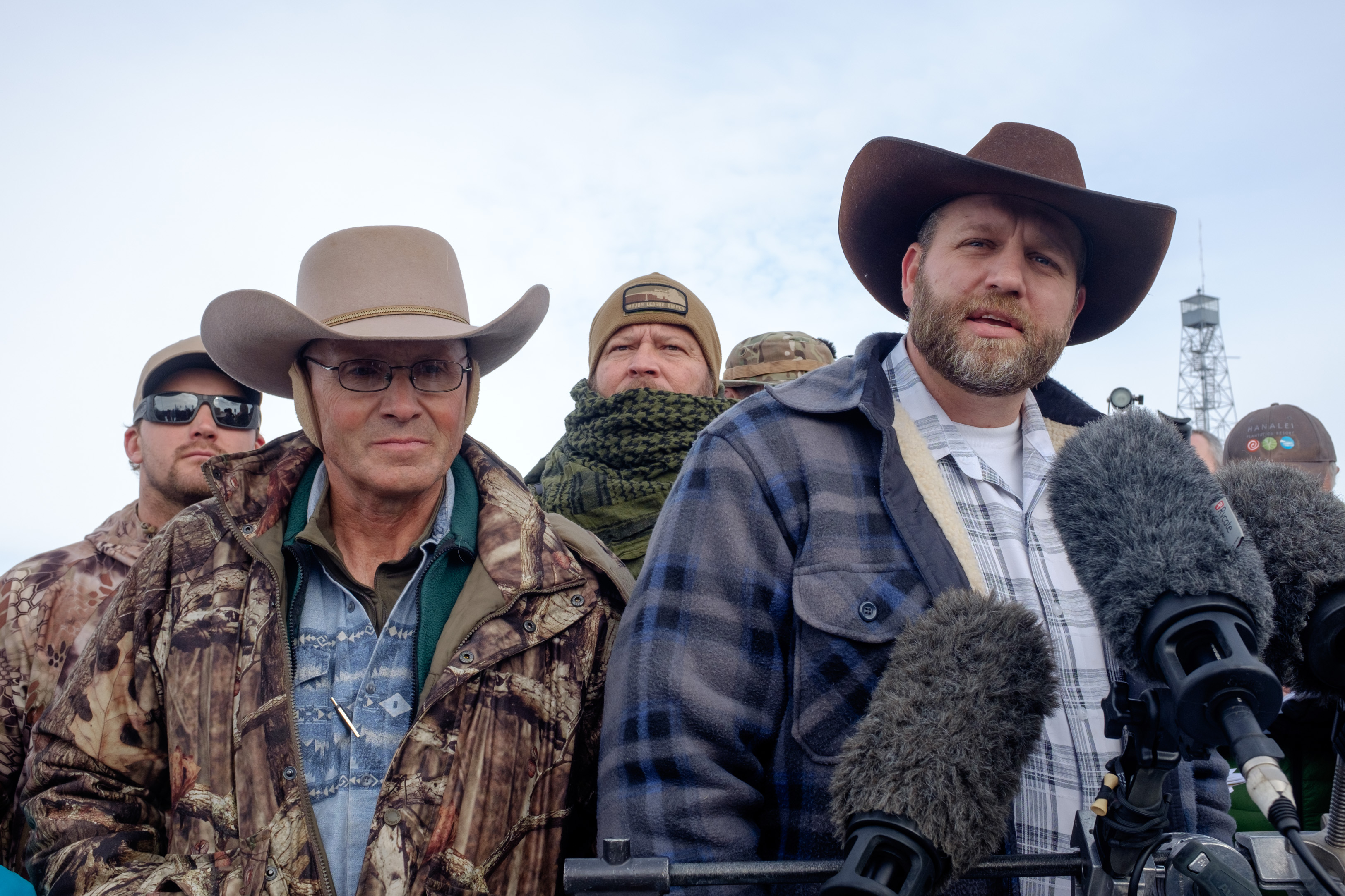 Ammon Bundy(R), leader of a group of armed anti-government protesters speaks to the media as other members look on at the Malheur National Wildlife Refuge near Burns, Ore., on Jan. 4, 2016.