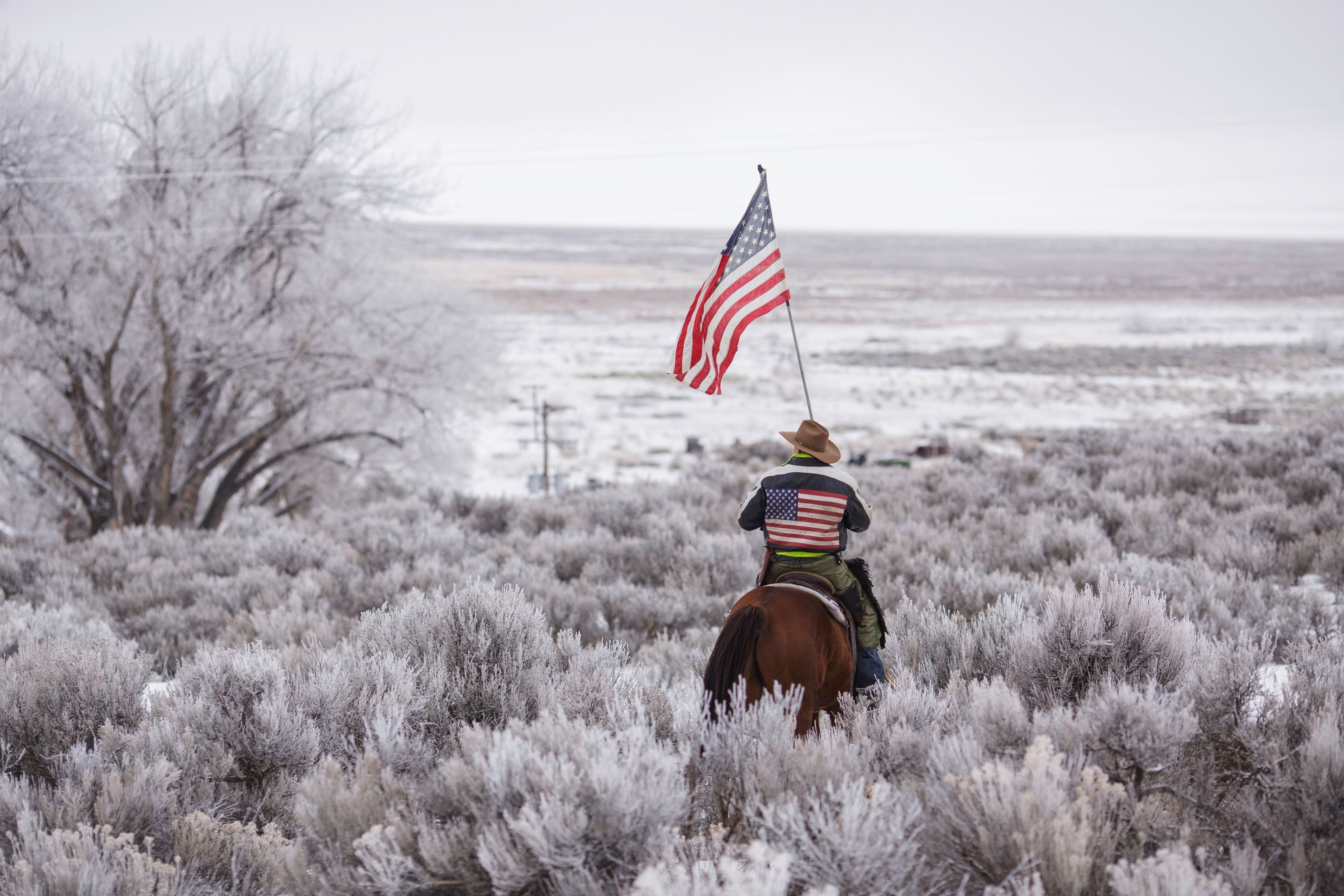 A man rides a horse at the occupied Malheur National Wildlife Refuge, on the sixth day of the occupation of the federal building, in Burns, Oregon, Jan. 7, 2016.