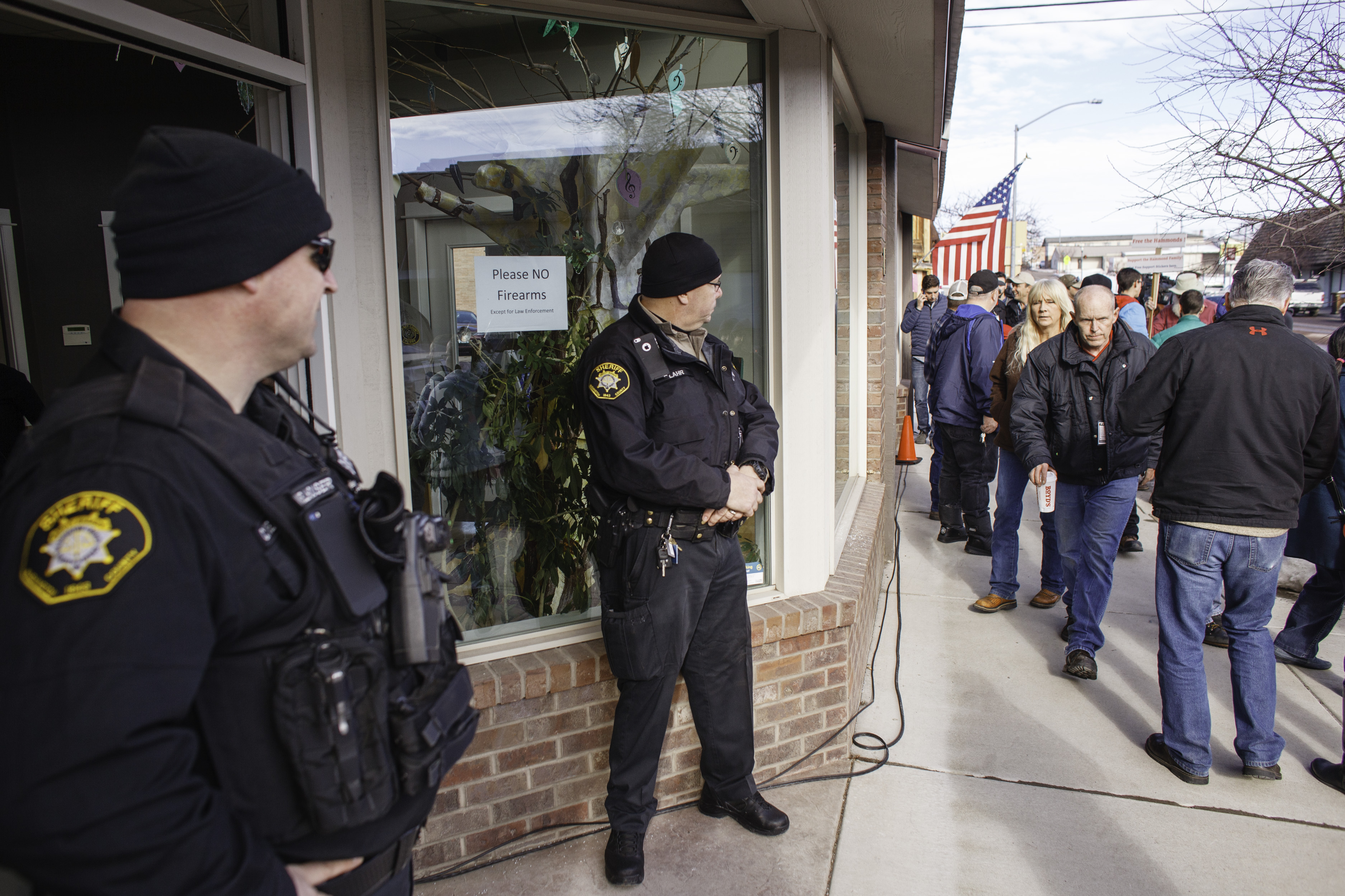 Washington County Sheriff Deputies monitor the public outside of the Harney County Chamber of Commerce where a press conference was being held in Burns, Oregon, on Jan. 27, 2016.