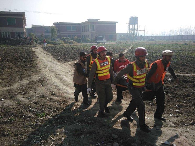 Rescuers move an injured victim outside Bacha Khan University following an attack by gunmen in Charsadda, northwest Pakistan, Jan. 20.