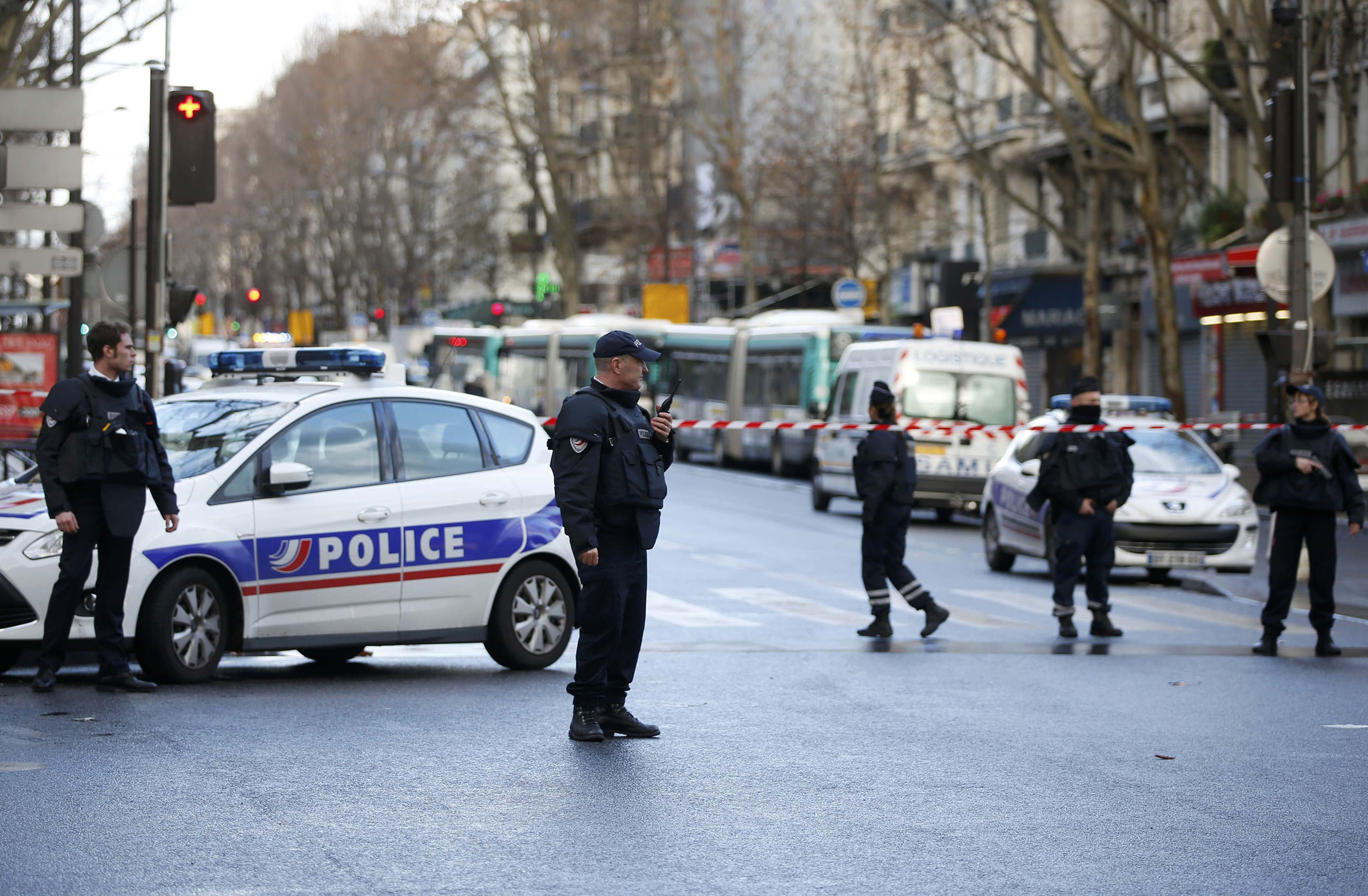 French police secure the area after a knife-wielding man was shot dead after attempting to enter a police station in the 18th district in Paris, Jan. 7, 2016.