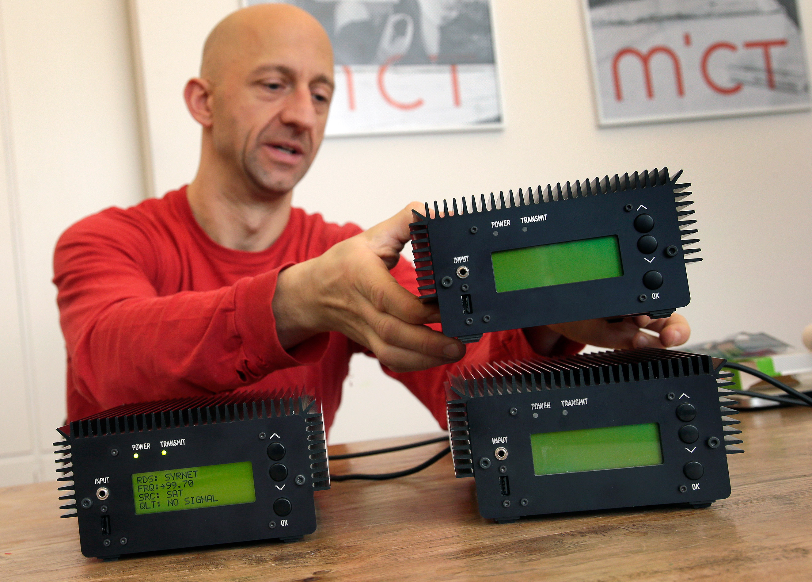 Philipp Hochleichter of the Media in Cooperation and Transition organization holds a Pocket FM Radio Transmitter in Berlin, Germany, Dec. 21, 2015. As part of the Syrian radio networking project, MICT has designed small modular FM transmitters.